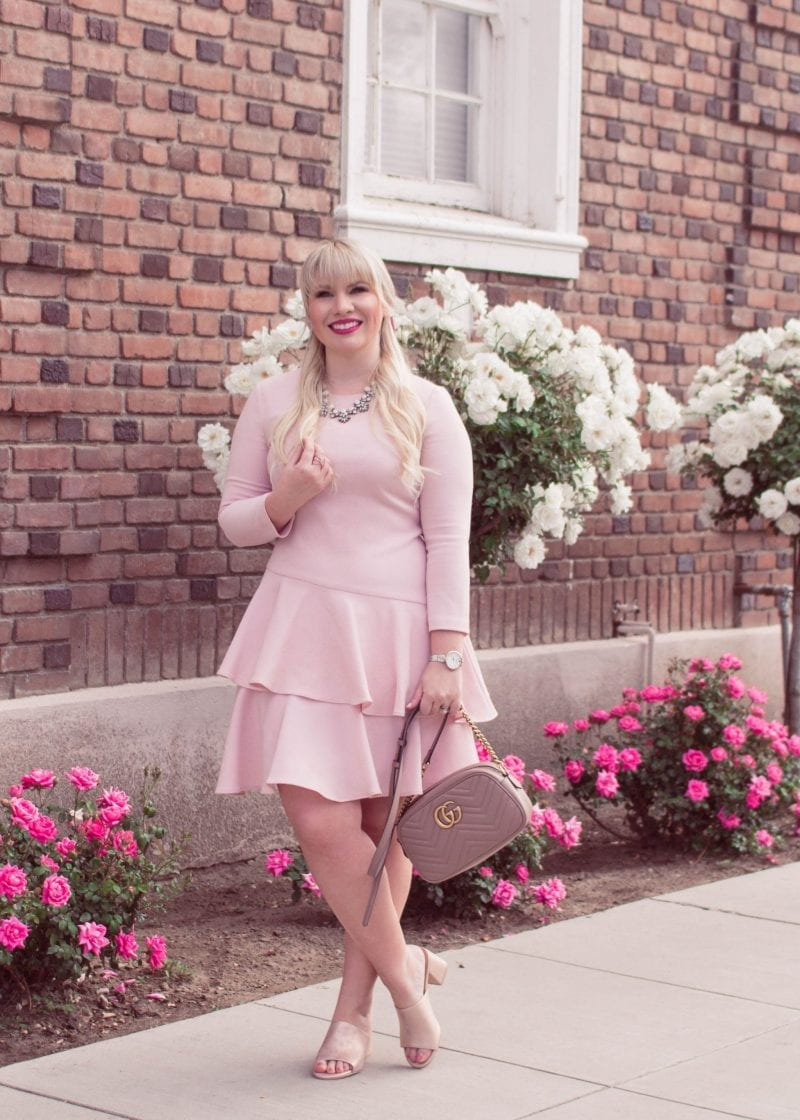 Elizabeth Hugen of Lizzie in Lace wears a pink dress with a Gucci Marmont bag
