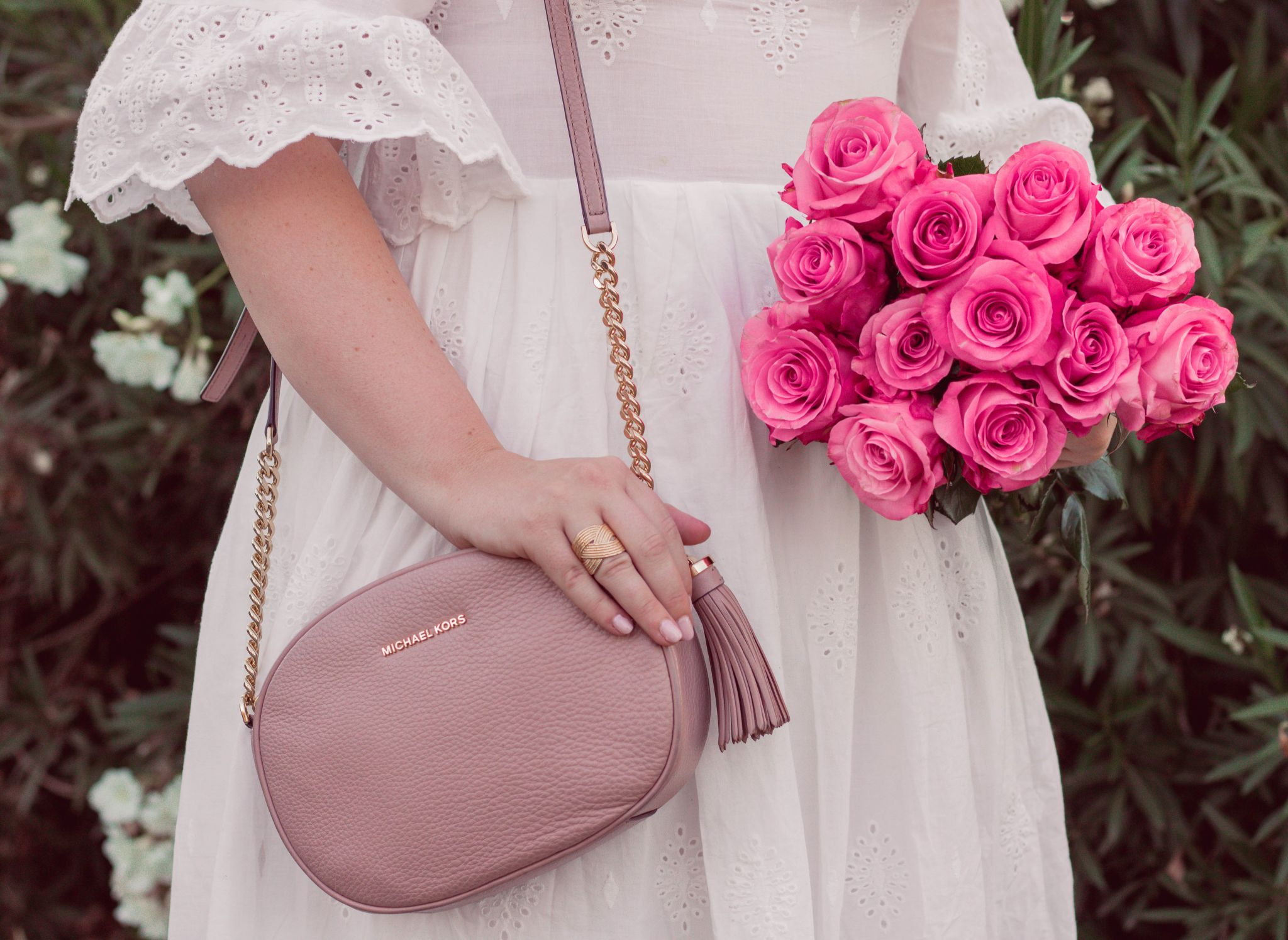 Fashion Blogger Elizabeth Hugen of Lizzie in Lace shares her girly handbag collection including this blush Michael Kors handbag