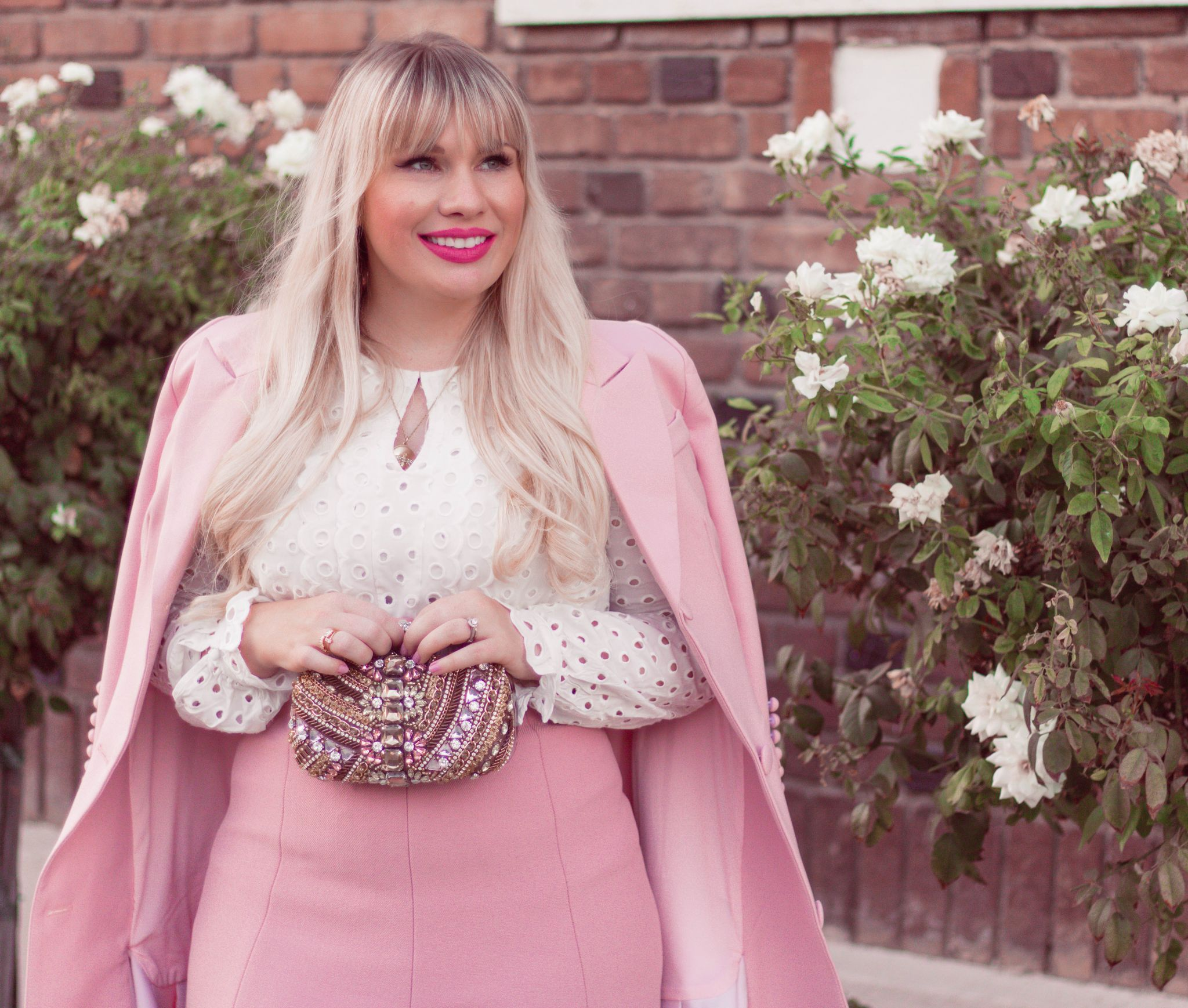 Fashion blogger Elizabeth Hugen of Lizzie in Lace shares 5 tips to make a pink outfit look sophisticated along with this feminine pink outfit idea with jeweled clutch