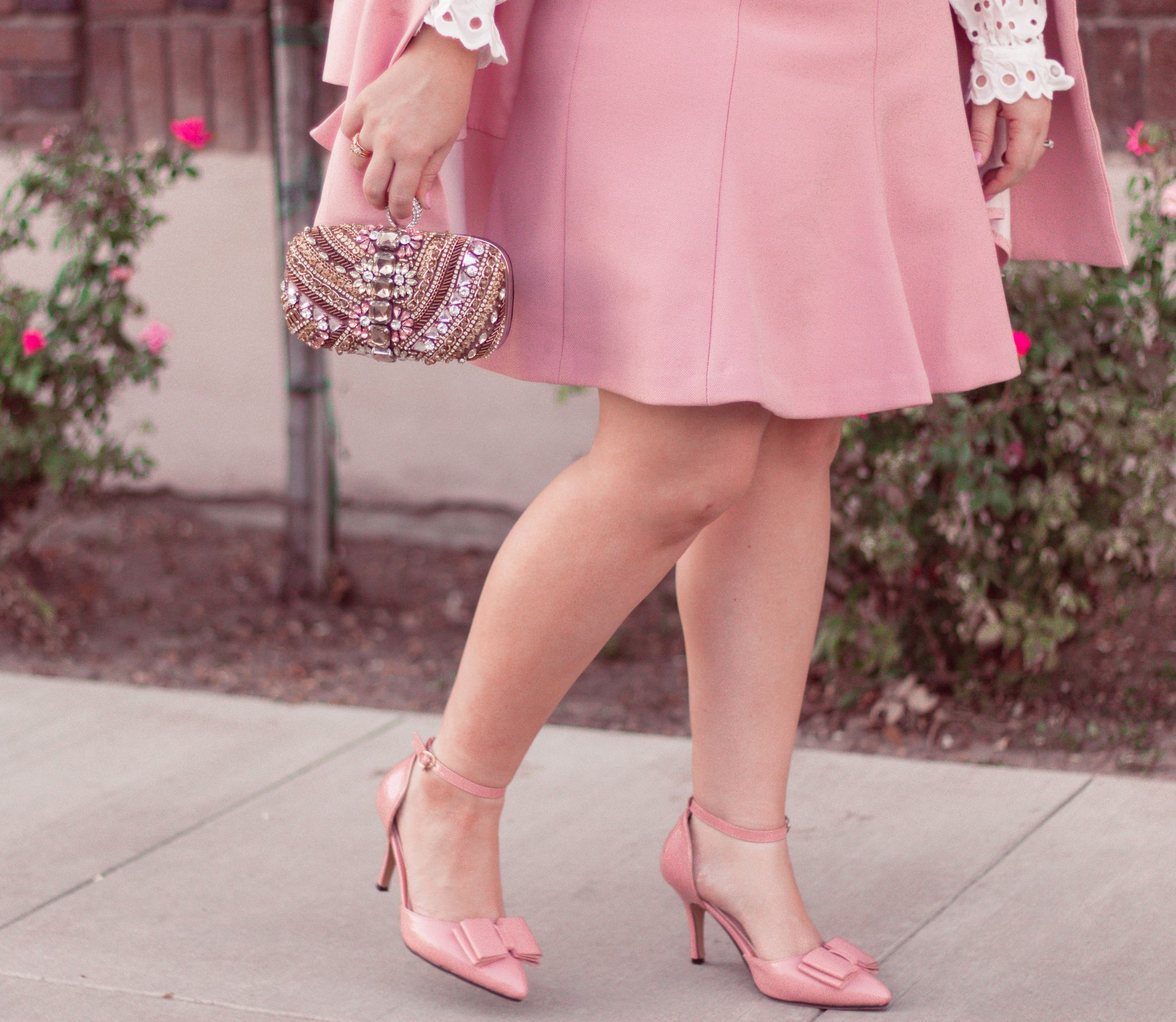 Elizabeth Hugen of Lizzie in Lace shares her girly shoe collection including these pink bow heels