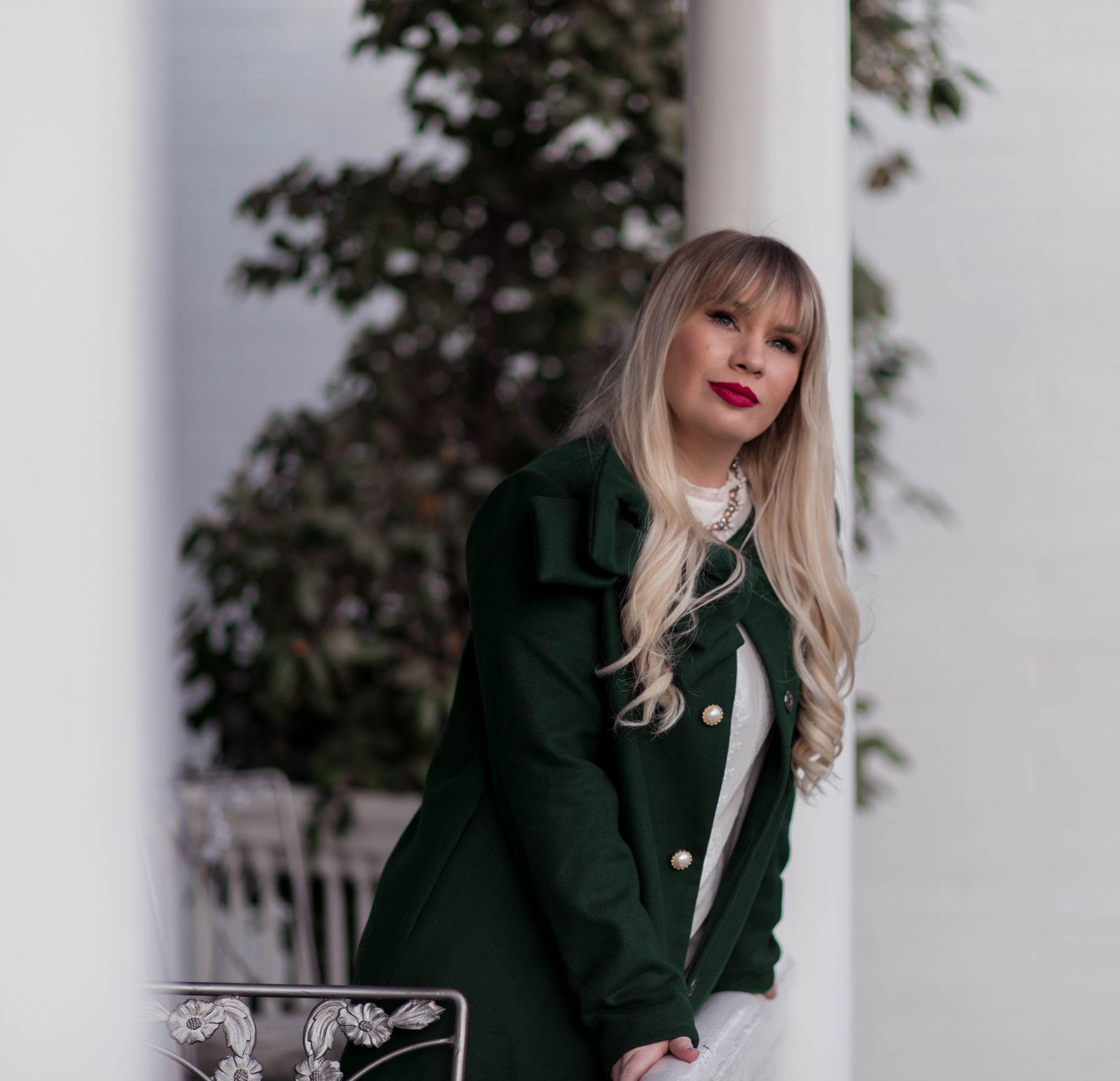 Elizabeth Hugen from Lizzie in Lace wears a green winter coat