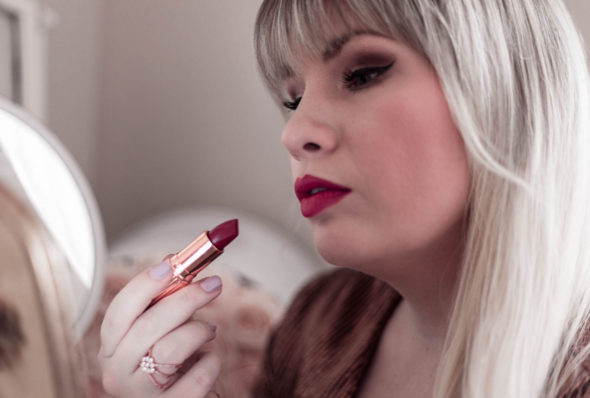 Fashion Blogger Elizabeth Hugen of Lizzie in Lace shares two holiday makeup looks from Charlotte Tilbury
