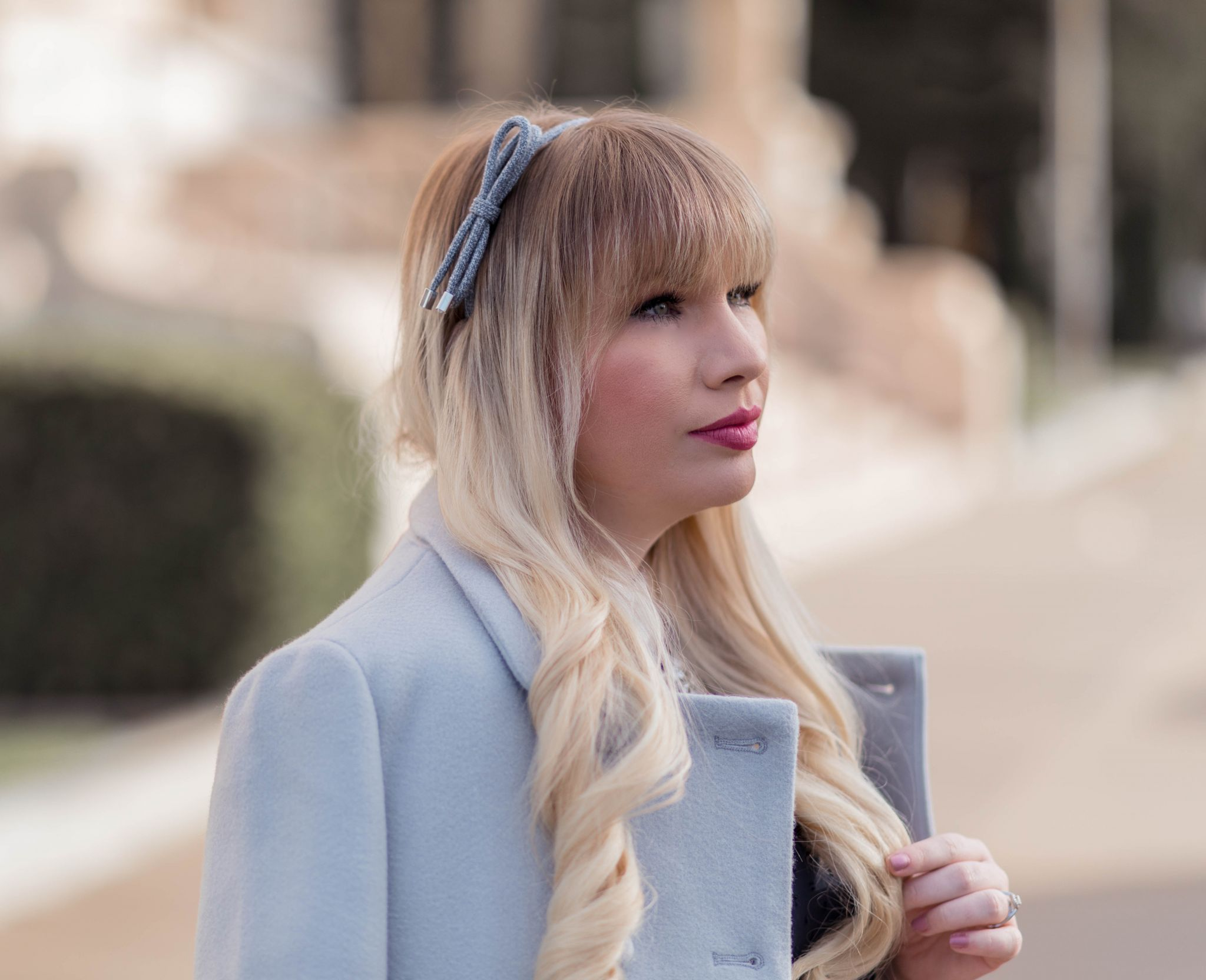 Feminine Fashion Blogger Elizabeth Hugen of Lizzie in Lace shares her girly hair accessories collection including this blue bow headband