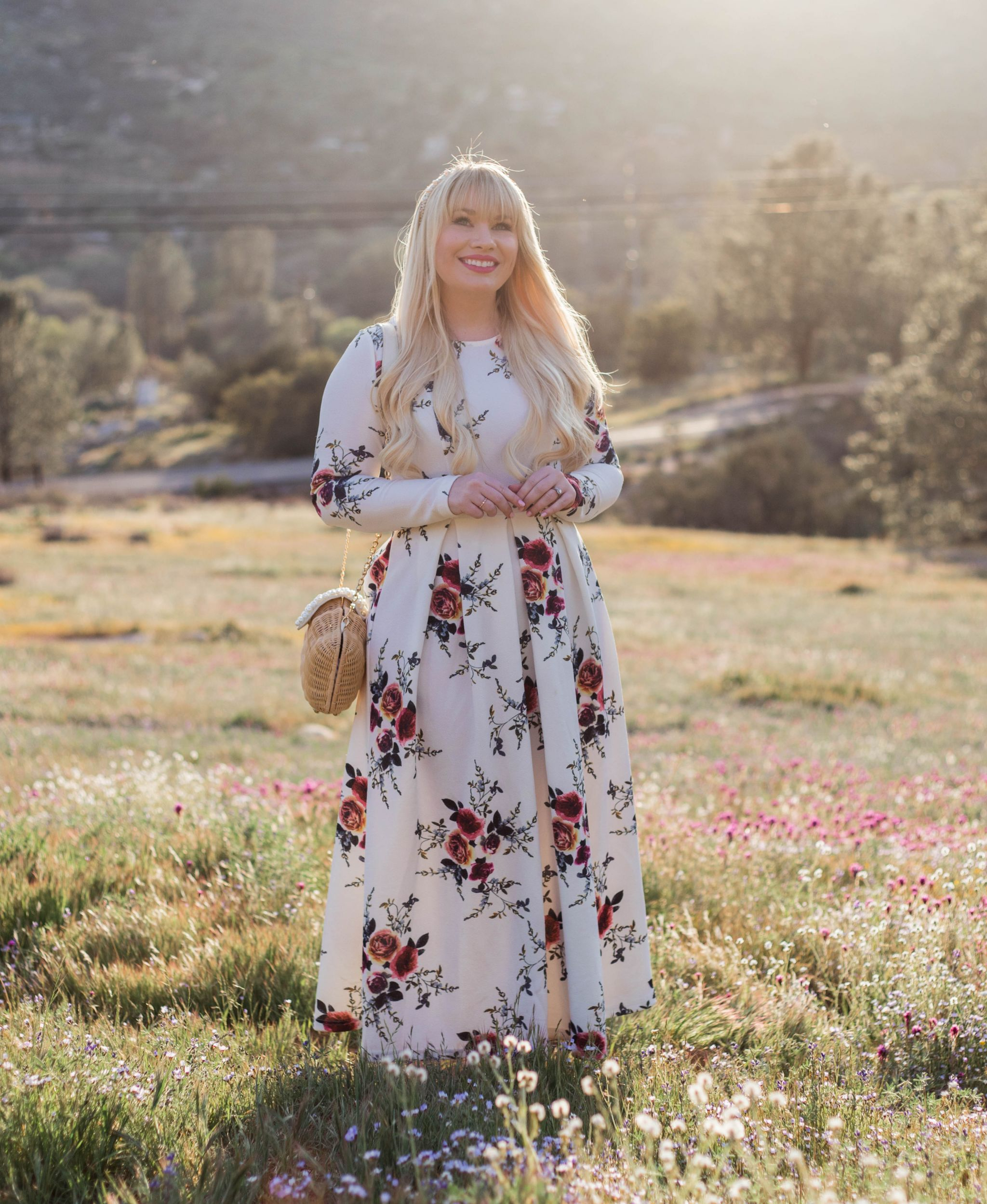 Elizabeth Hugen of Lizzie in Lace styles a white floral maxi dress and shares her Ultimate Blogger Photography Guide