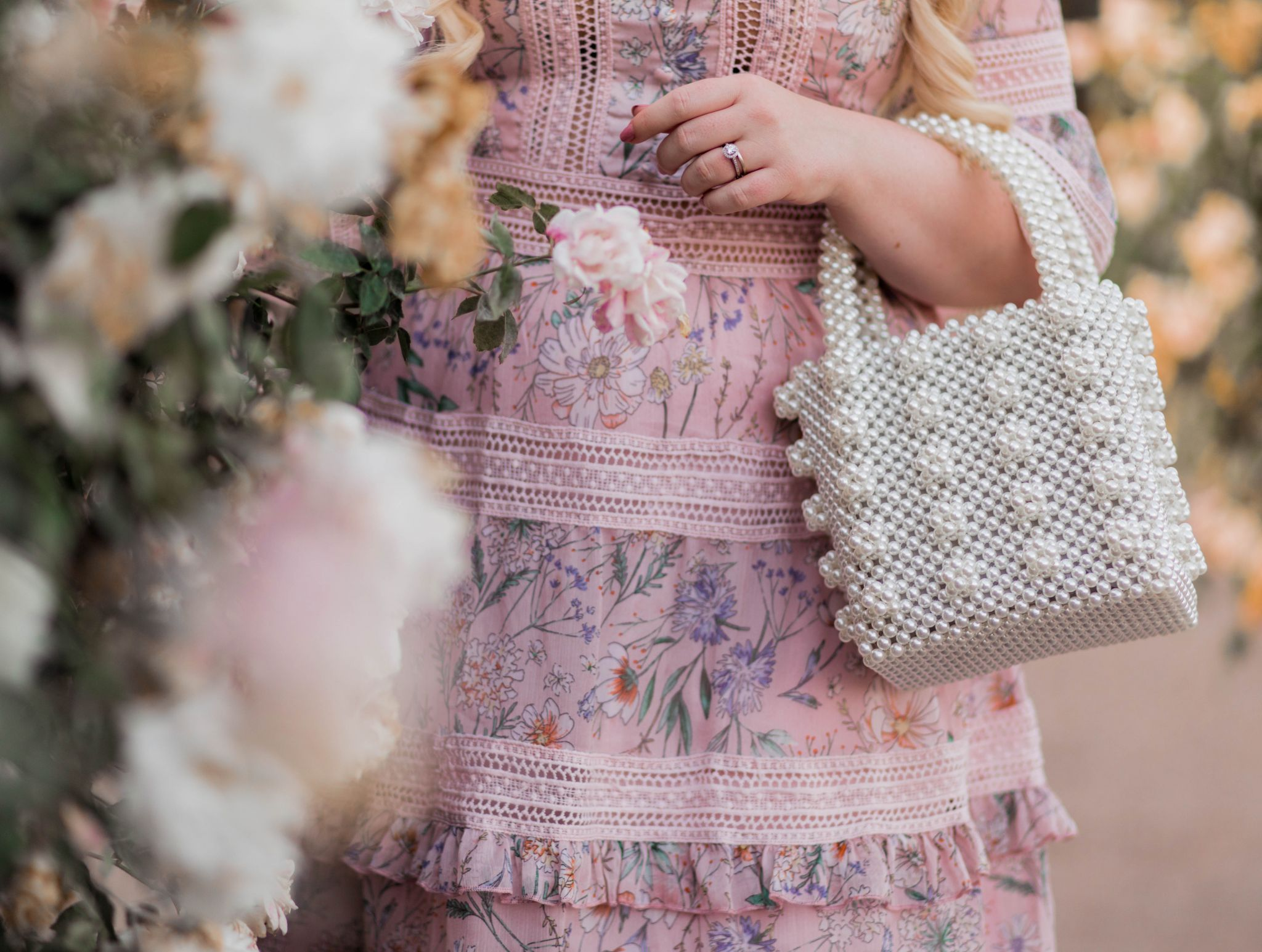 Fashion Blogger Elizabeth Hugen of Lizzie in Lace shares her girly handbag collection including this pearl handbag