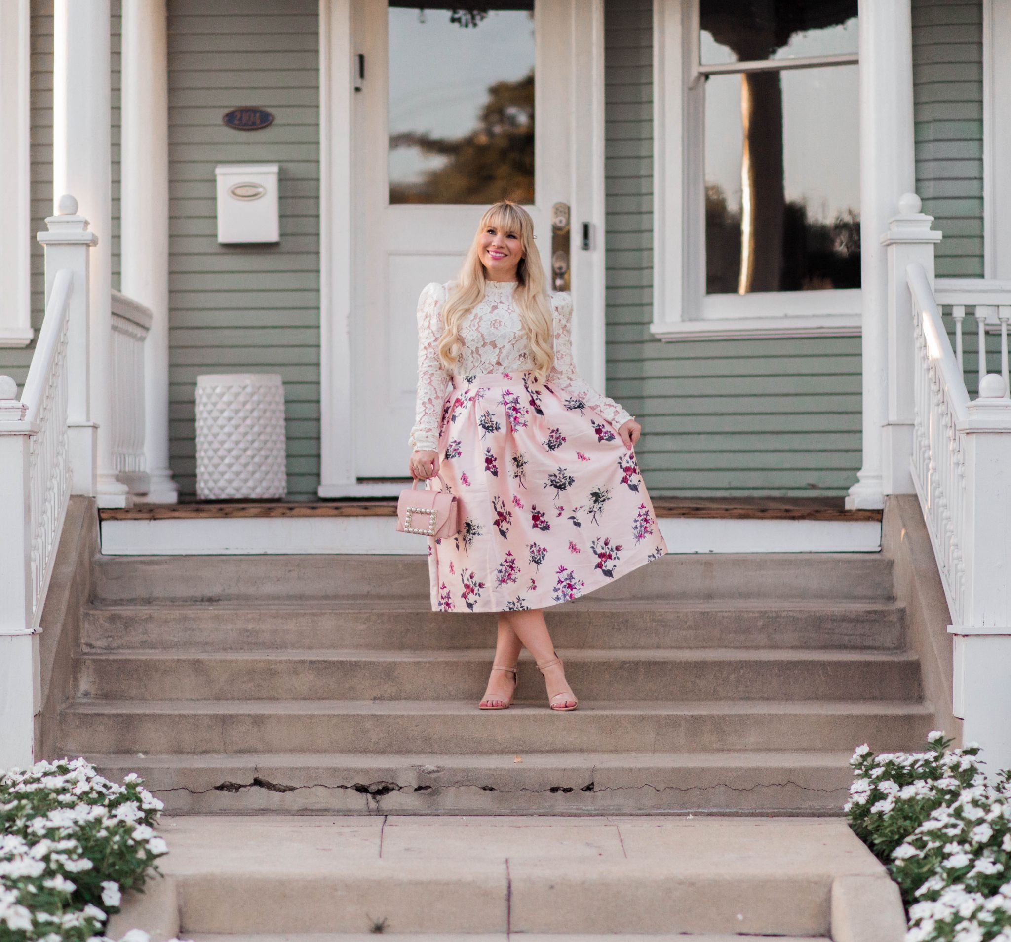 California fashion blogger, Elizabeth Hugen, styles the perfect feminine white lace top with a floral skirt.