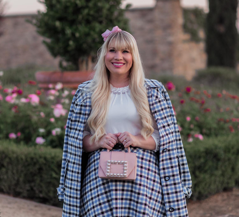 Elizabeth Hugen of Lizzie in Lace styles a blush pearl Kate spade handbag.
