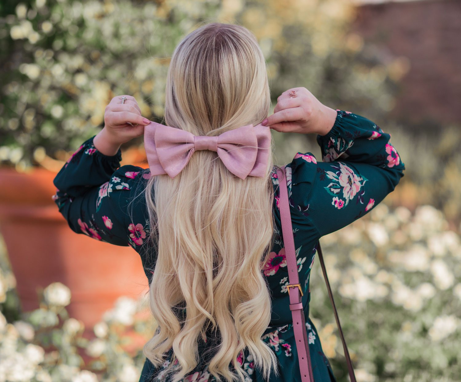 Feminine Fashion Blogger Elizabeth Hugen of Lizzie in Lace shares her girly hair accessories collection including this pink hair bow