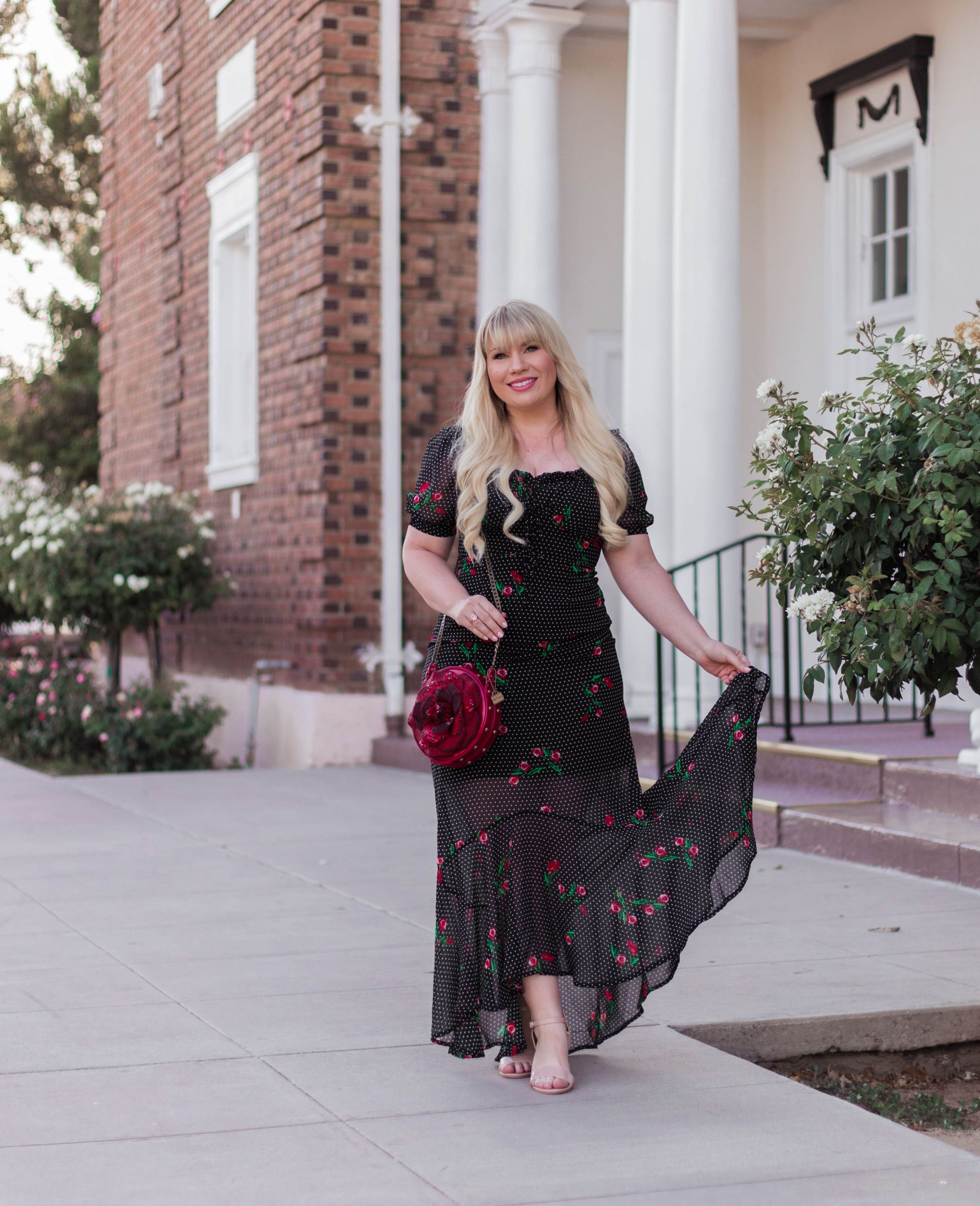 Elizabeth Hugen of Lizzie in Lace styles a beautiful Disney inspired handbag with a black polka dot and rose dress.