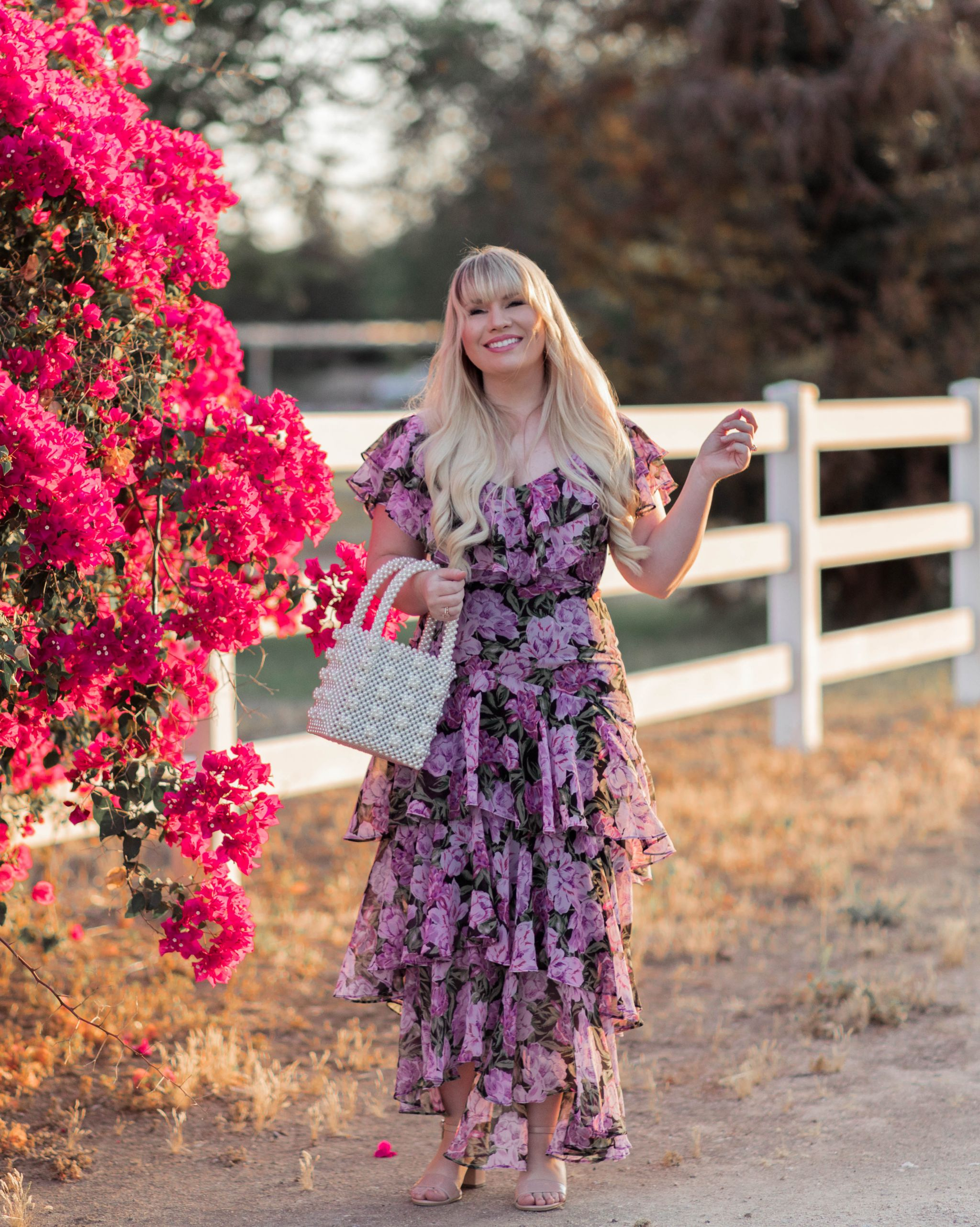 Elizabeth Hugen from Lizzie in Lace wears a purple floral summer dress
