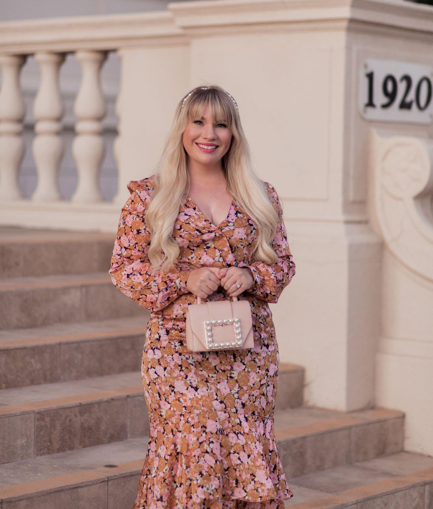 Elizabeth Hugen of Lizzie in Lace styles a blush pink Kate Spade pearl handbag!