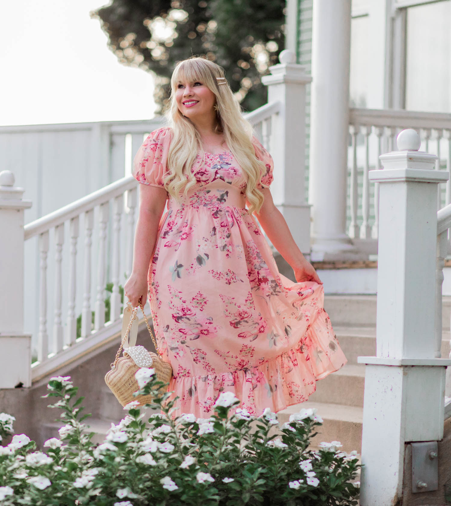Elizabeth Hugen of Lizzie in Lace wears a pink floral ruffle dress!