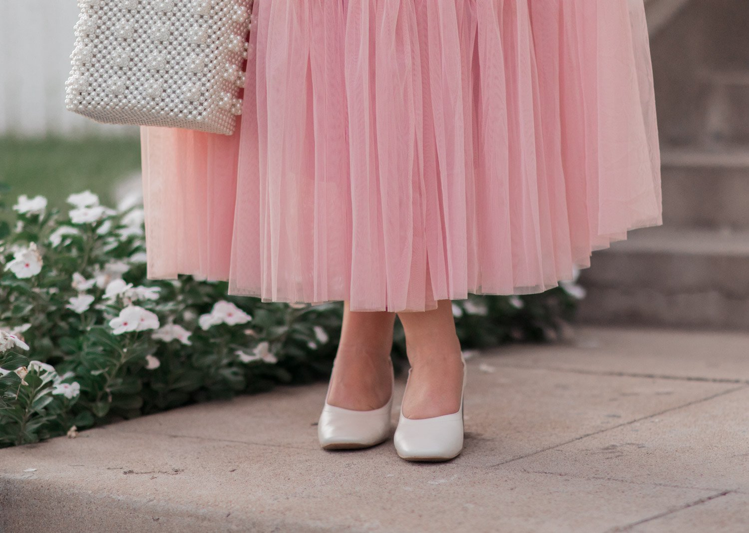 Elizabeth Hugen of Lizzie in Lace styles a pink tulle skirt and Everlane heels!