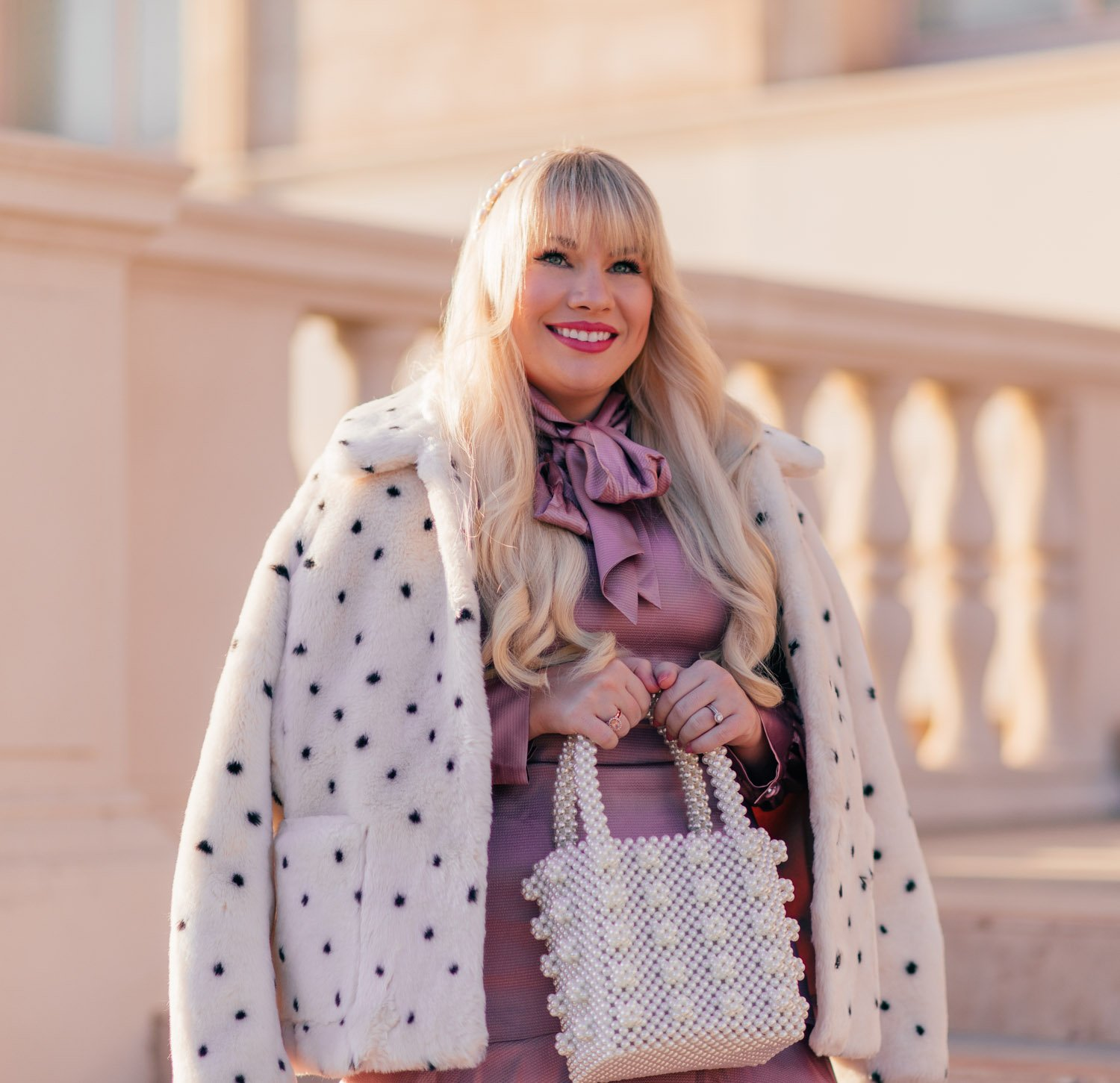 Elizabeth Hugen of Lizzie in Lace wears a glamorous leopard print coat for fall!
