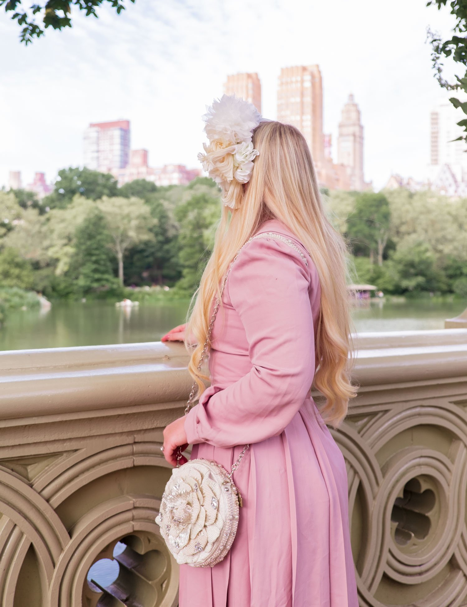 Elizabeth Hugen of Lizzie in Lace wears a floral Merve Bayindir headband and pink Shopyte dress in a NYFW Q & A!