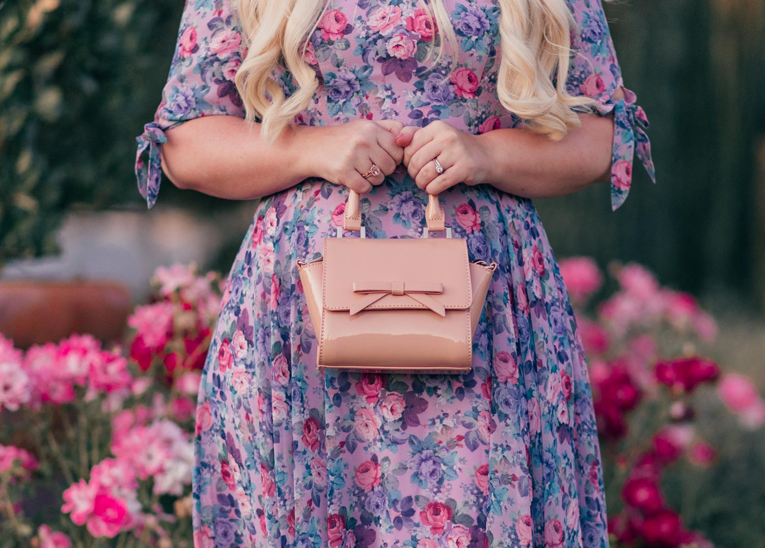 Fashion Blogger Elizabeth Hugen of Lizzie in Lace shares her girly handbag collection including this nude bow handbag