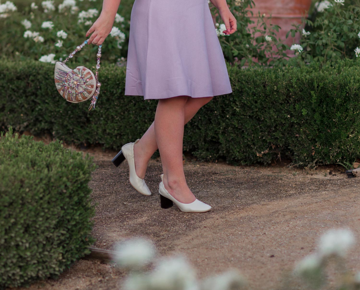 Elizabeth Hugen of Lizzie in Lace wears a lilac Eliza J sweater dress, Everlane day heel and Mary Frances handbag!