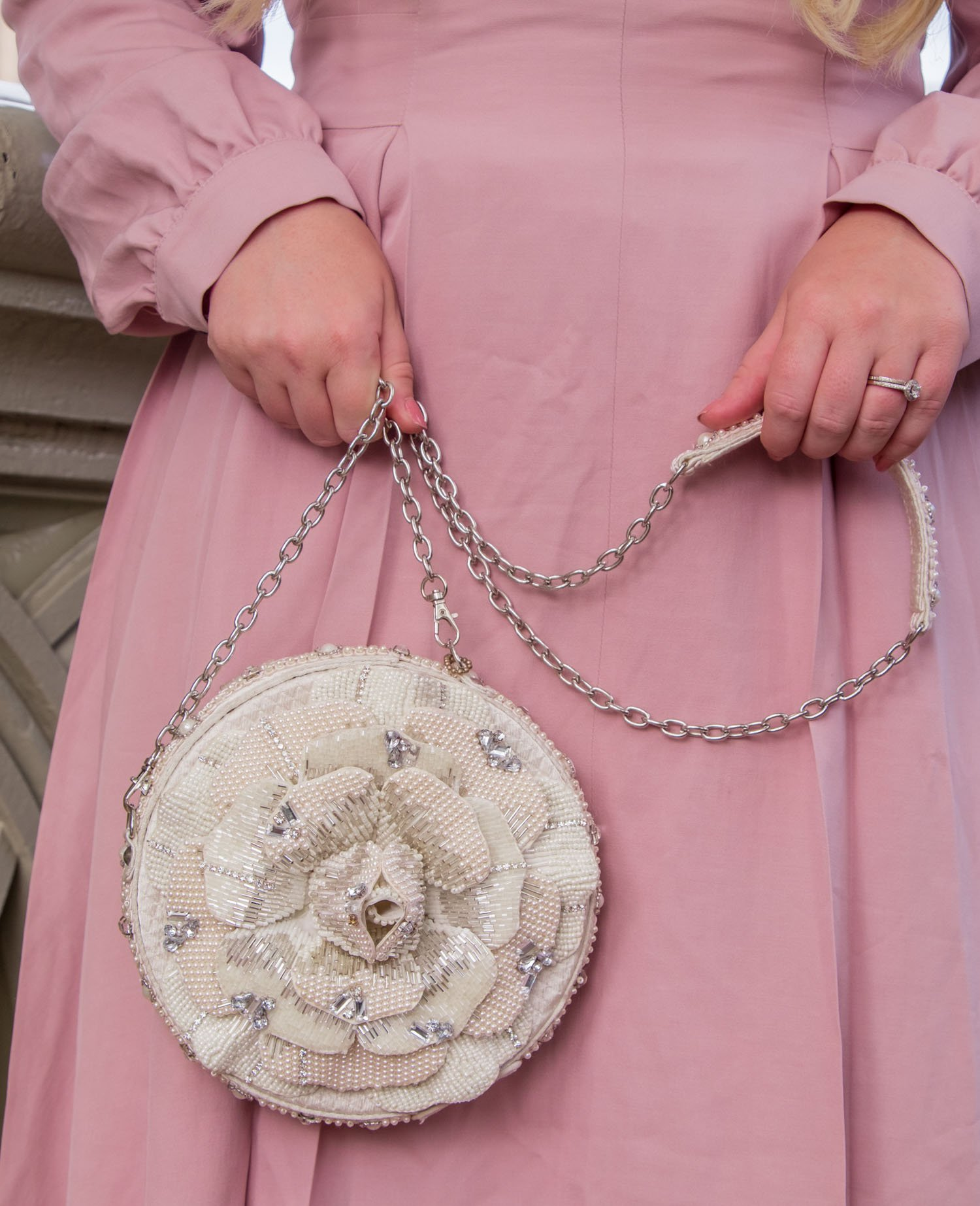 Elizabeth Hugen of Lizzie in Lace wears a floral Mary Frances handbag!