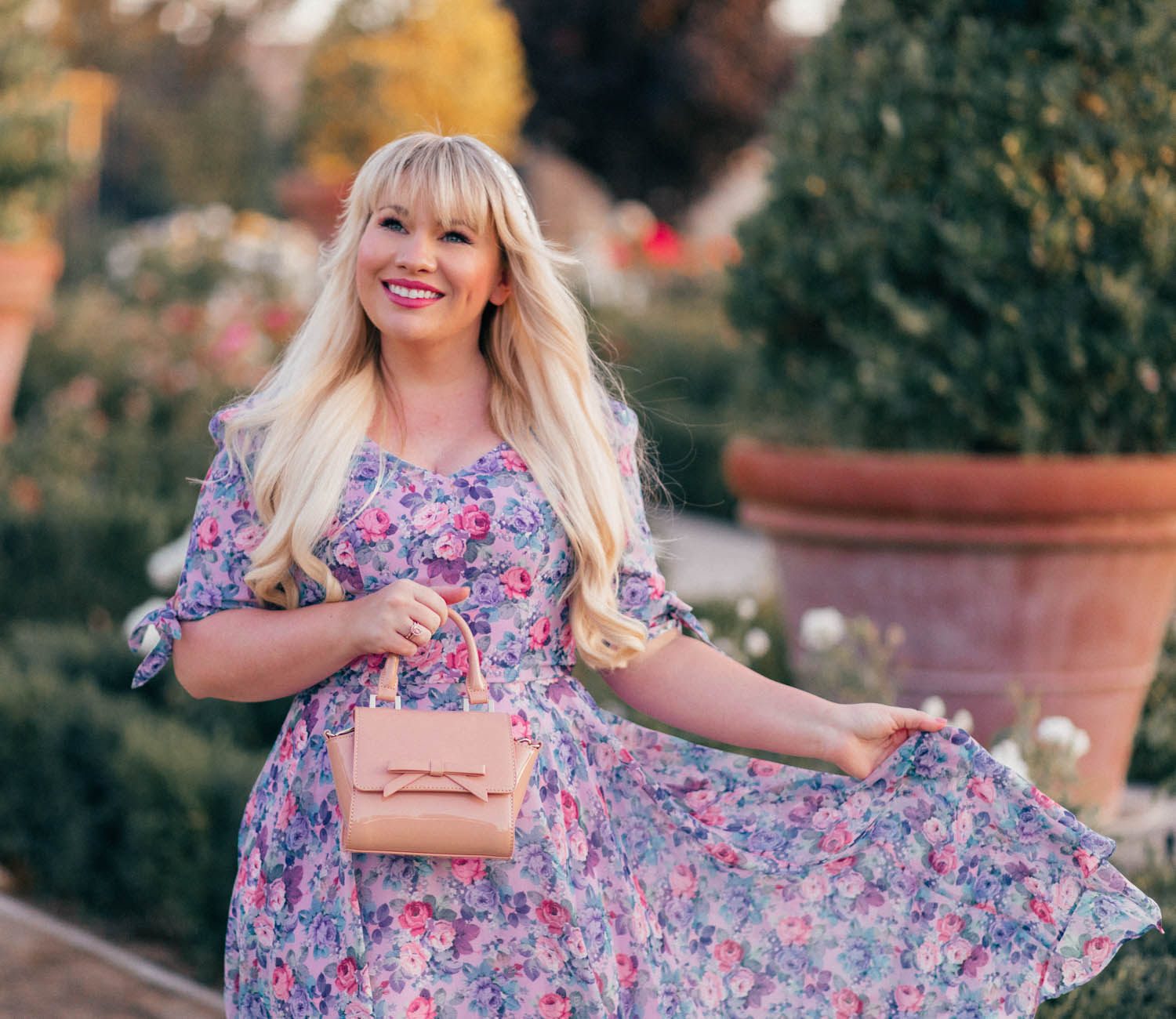 Elizabeth Hugen of Lizzie in Lace wears a purple floral dress from Review Australia!