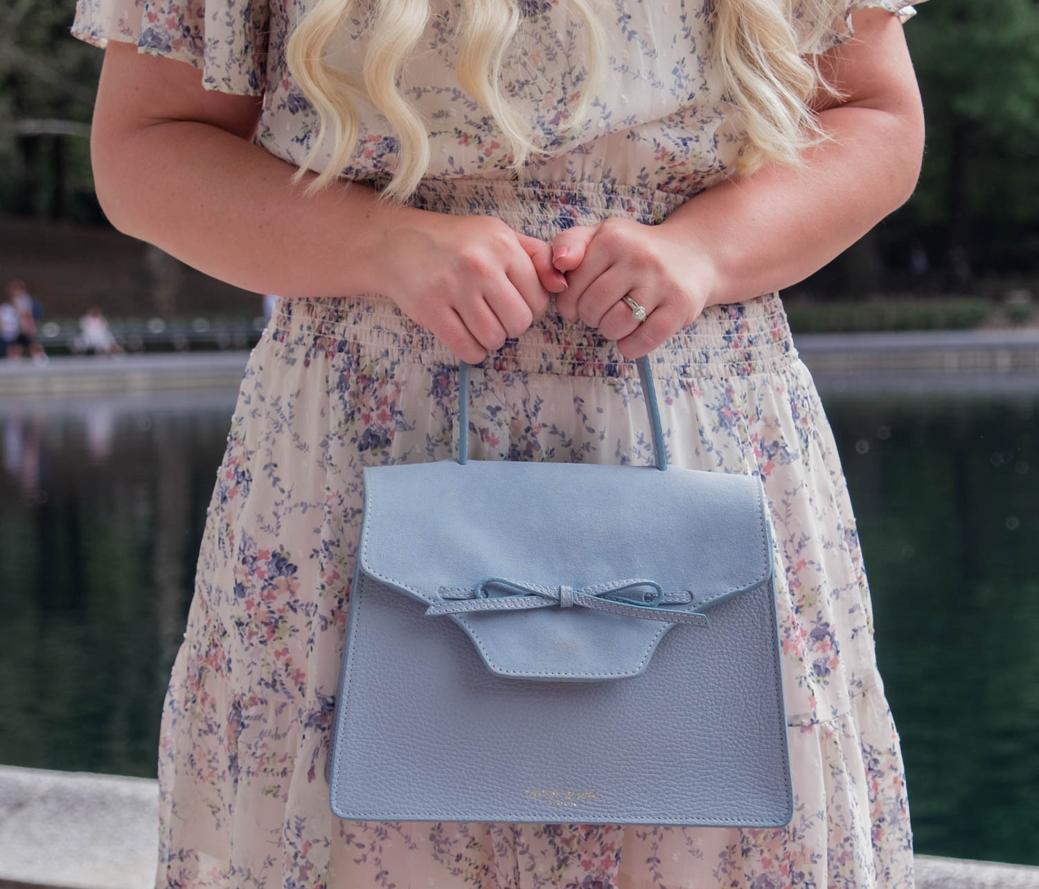 Elizabeth Hugen of Lizzie in Lace wears the Elliatt Wish dress and Teddy Blake handbag to NYFW!