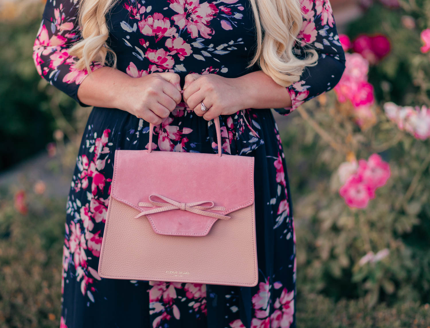 Fashion Blogger Elizabeth Hugen of Lizzie in Lace shares her girly handbag collection including this Teddy Blake handbag
