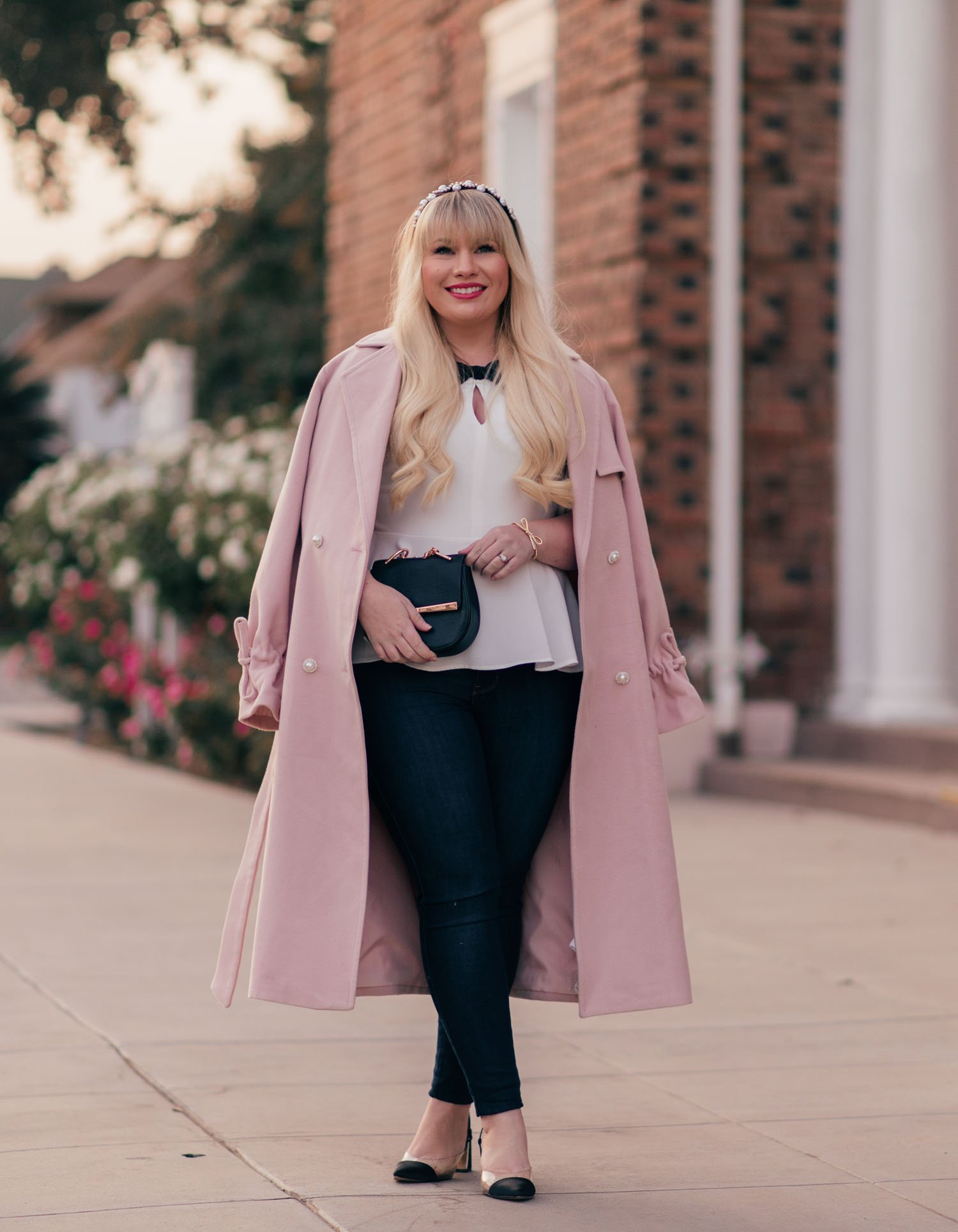 Elizabeth Hugen of Lizzie in Lace wears a pink winter coat