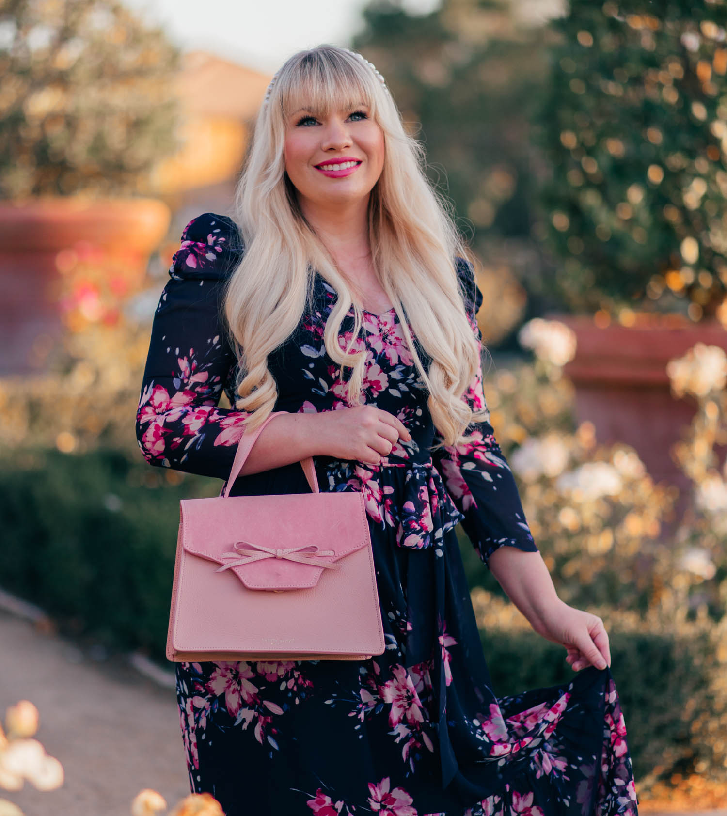 Elizabeth Hugen of Lizzie in Lace styles a Teddy Blake Pink Handbag with her fall floral dress!