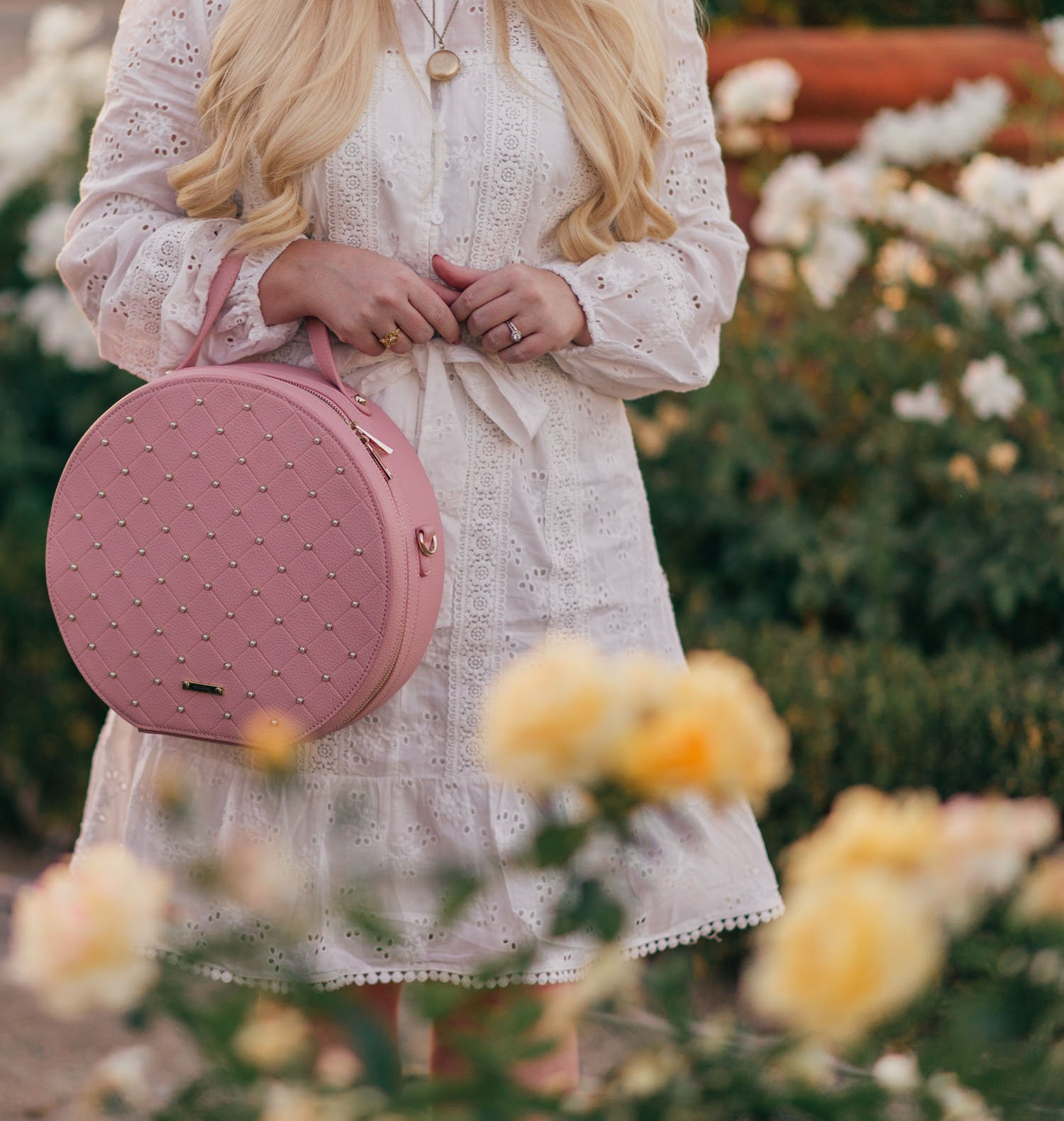 Elizabeth Hugen of Lizzie in Lace styles a feminine white and pink outfit.