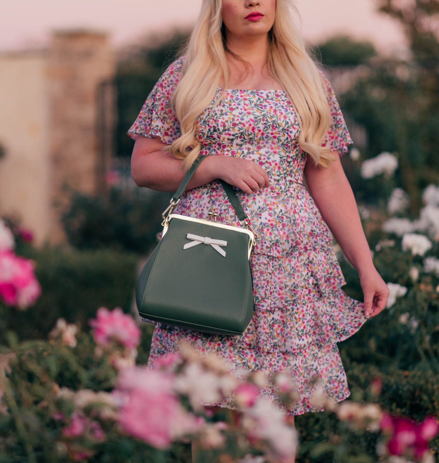 Fashion Blogger Elizabeth Hugen of Lizzie in Lace shares her girly handbag collection including this vintage inspired bow handbag