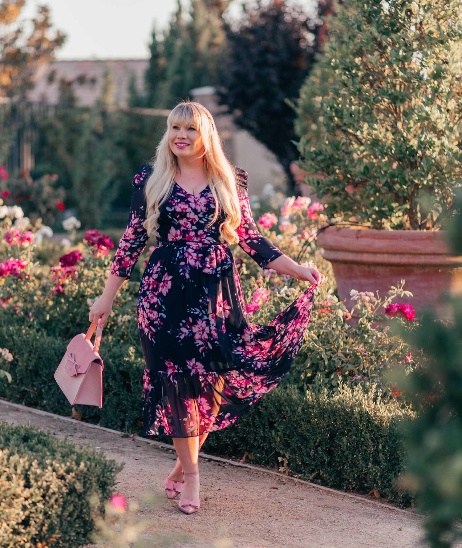 Elizabeth Hugen of Lizzie in Lace wears a Navy Fall Floral Dress from Eliza J!