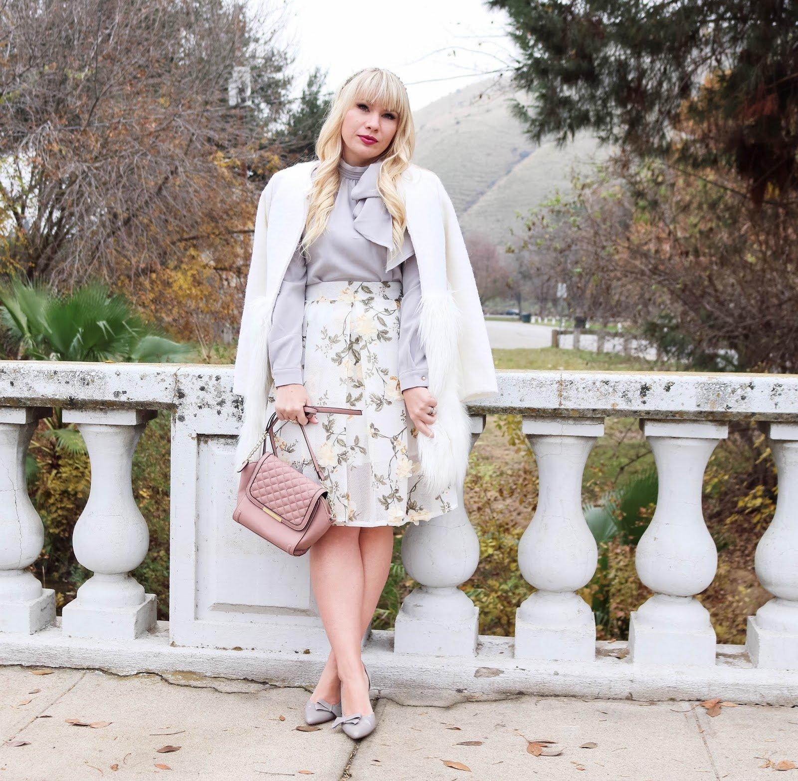 Elizabeth Hugen from Lizzie in Lace wears a white winter coat