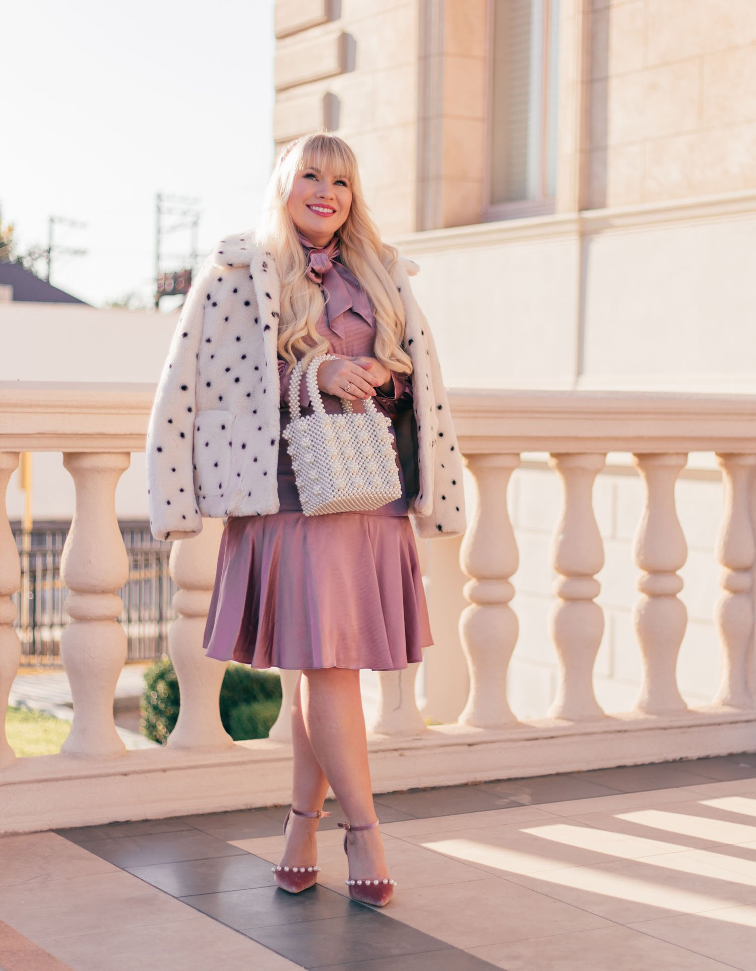 Elizabeth Hugen of Lizzie in Lace styles a faux fur leopard coat for winter!