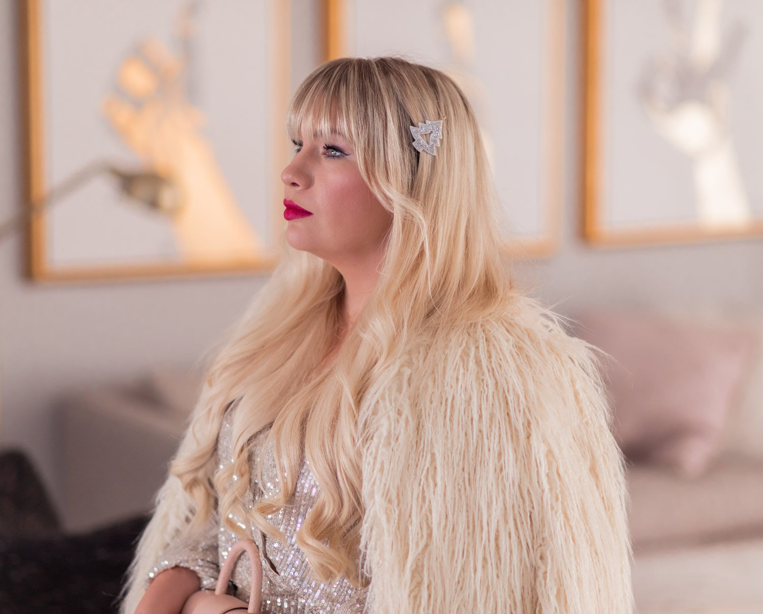 Elizabeth Hugen of Lizzie in Lace shares a feminine holiday outfit idea featuring New Years eve hair.