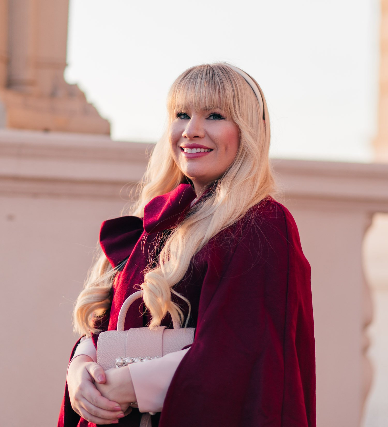 Elizabeth Hugen of Lizzie in Lace shares how to style a cape for fall along with her white headband!
