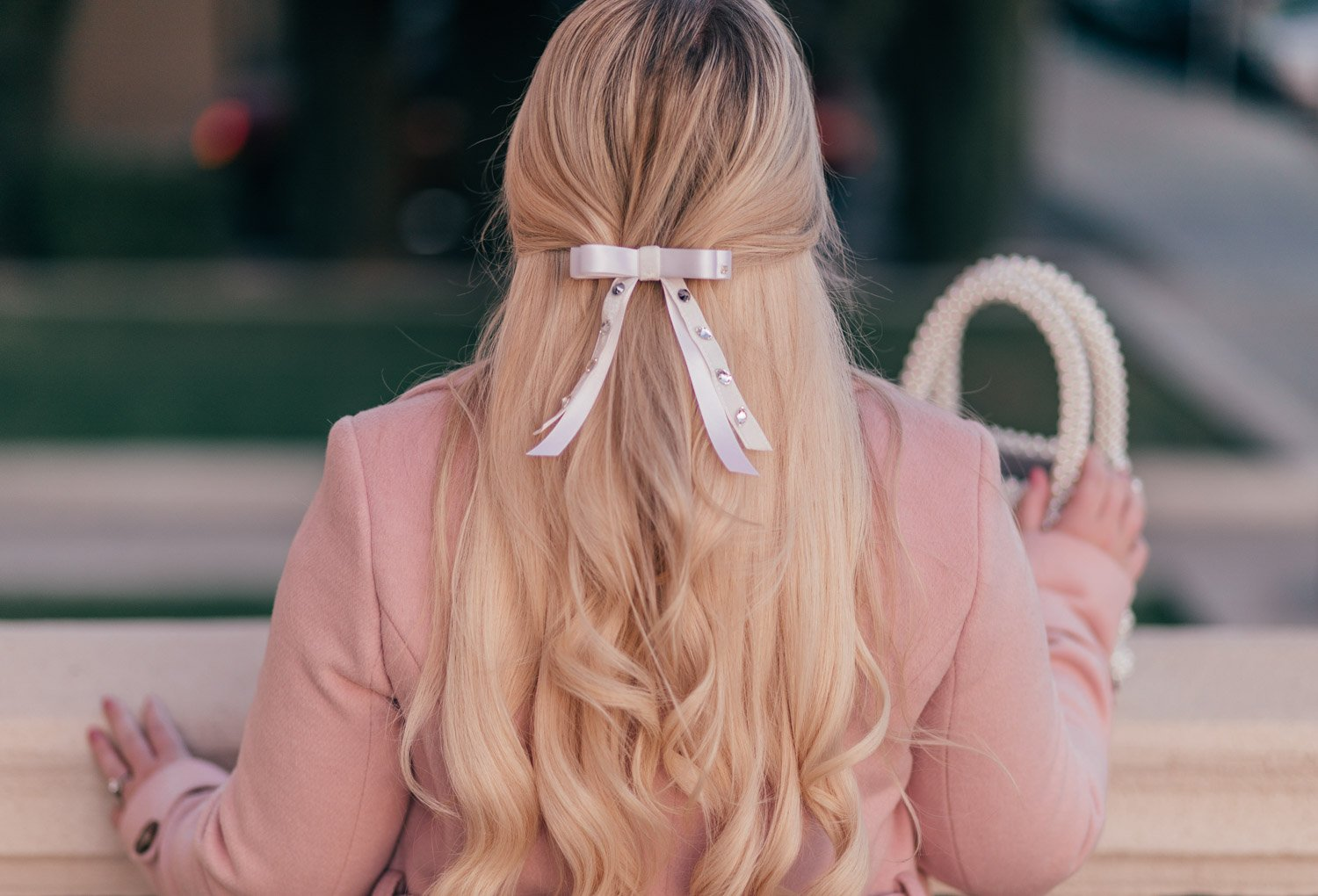 Feminine Fashion Blogger Elizabeth Hugen of Lizzie in Lace shares her girly hair accessories collection including this white hair bow