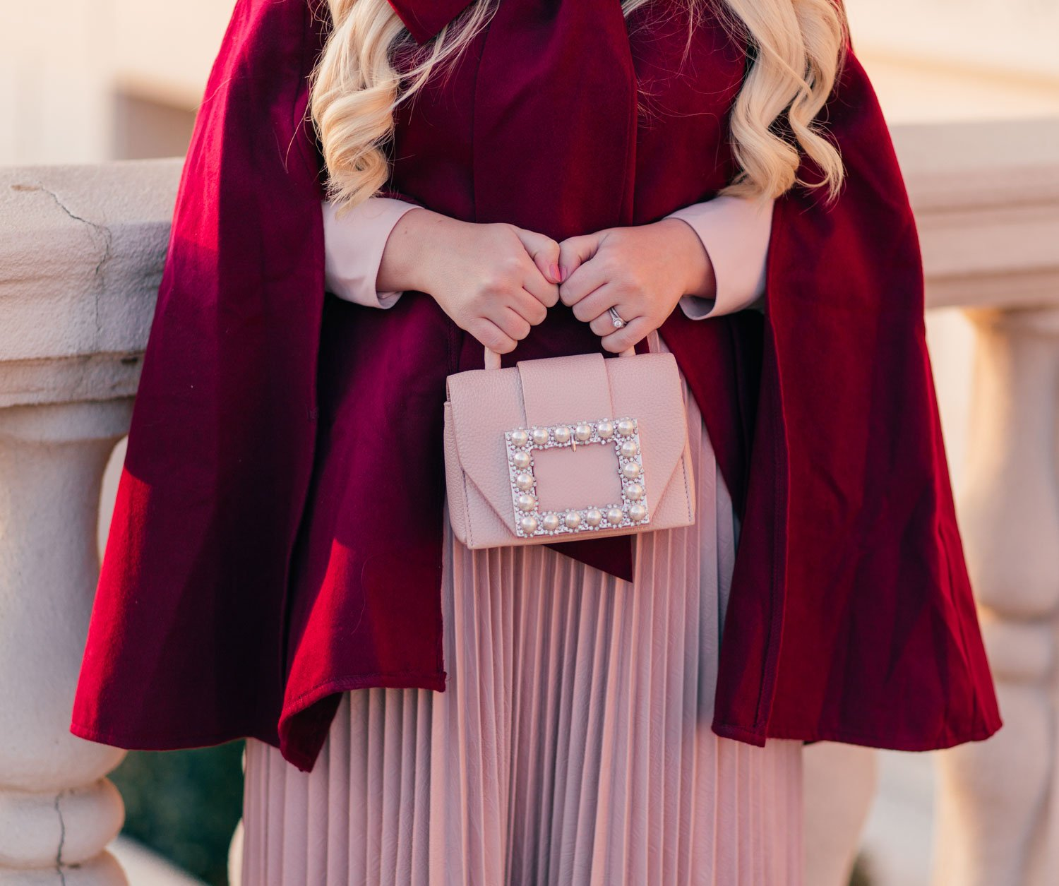 Elizabeth Hugen of Lizzie in Lace shares how to style a cape for fall along with her pink Kate spade handbag!