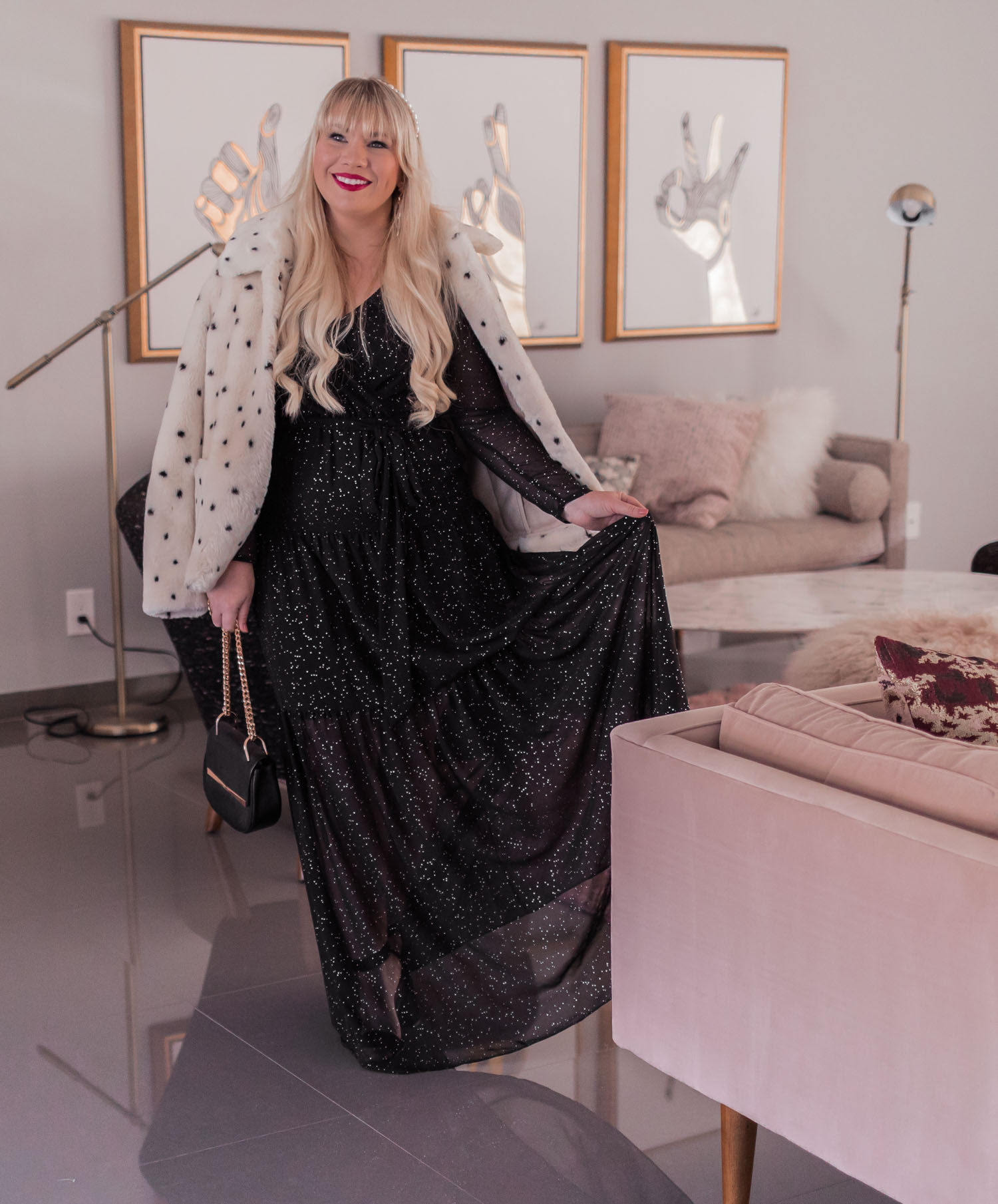 Elizabeth Hugen of Lizzie in Lace shares a feminine holiday outfit idea featuring a black sparkly maxi dress.