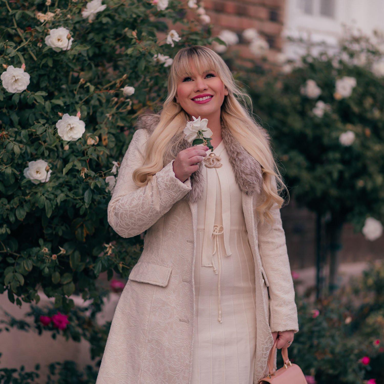 Elizabeth Hugen of Lizzie in Lace styles a feminine winter white outfit.