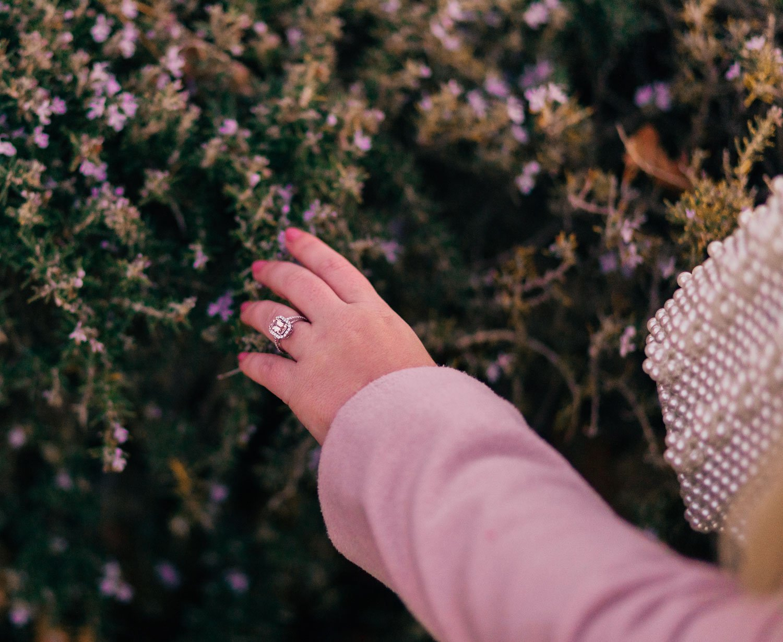 Elizabeth Hugen of Lizzie in Lace wears a Morganite princess ring