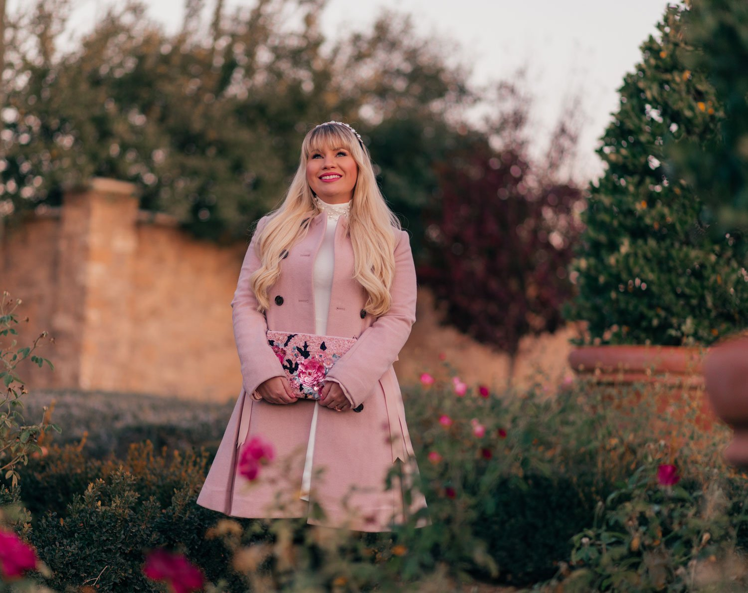 Elizabeth Hugen of Lizzie in Lace styles a feminine white and pink winter outfit