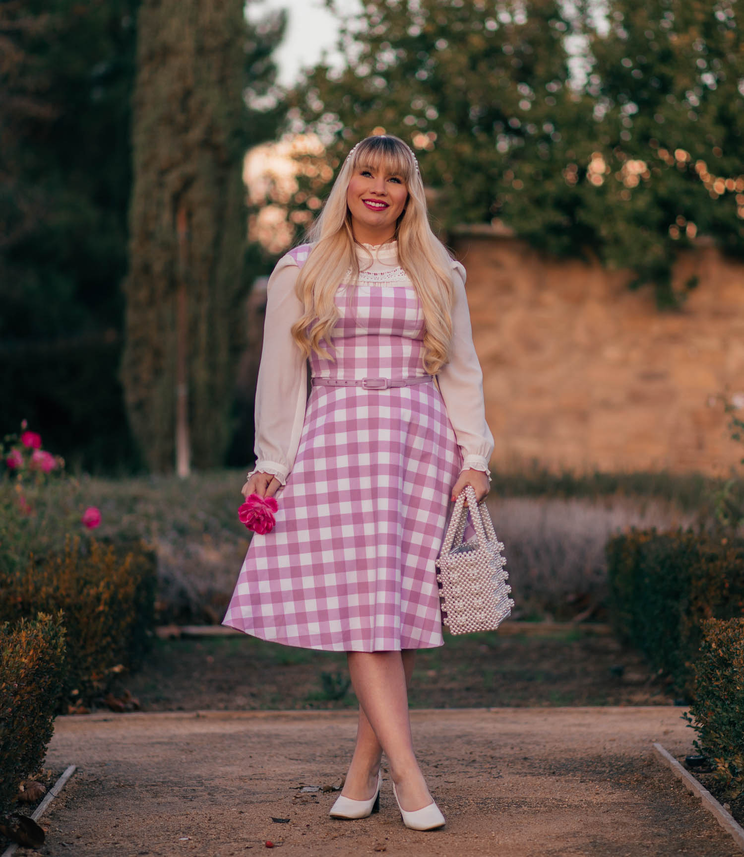 Elizabeth Hugen of Lizzie in Lace styles a purple gingham dress