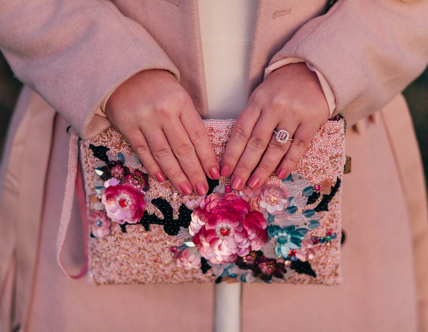 Elizabeth Hugen of Lizzie in Lace wears a Morganite princess ring and Mary Frances floral handbag