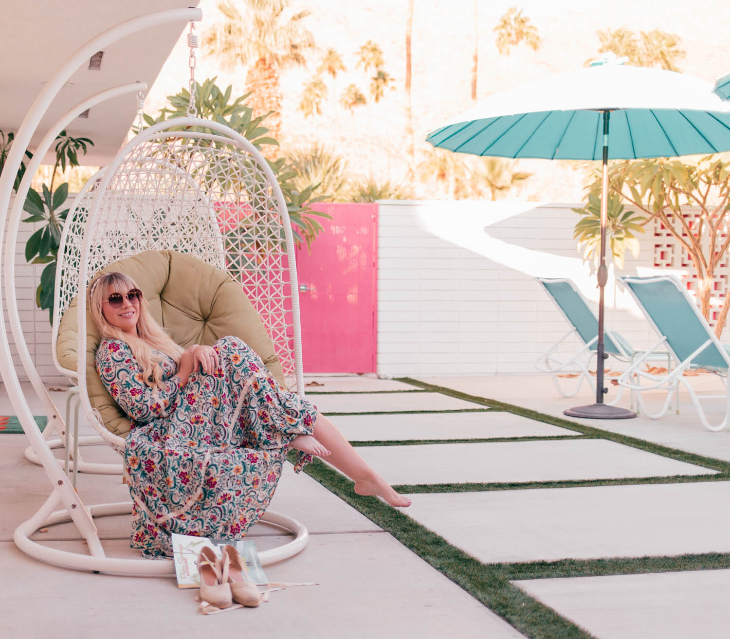 Elizabeth Hugen of Lizzie in Lace wears a floral Palm Springs style dress