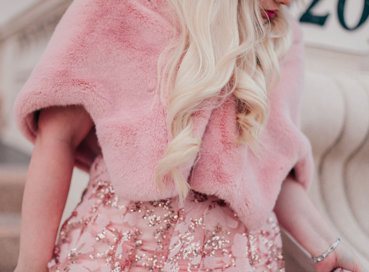 Elizabeth Hugen of Lizzie in Lace wears a pink faux fur stole