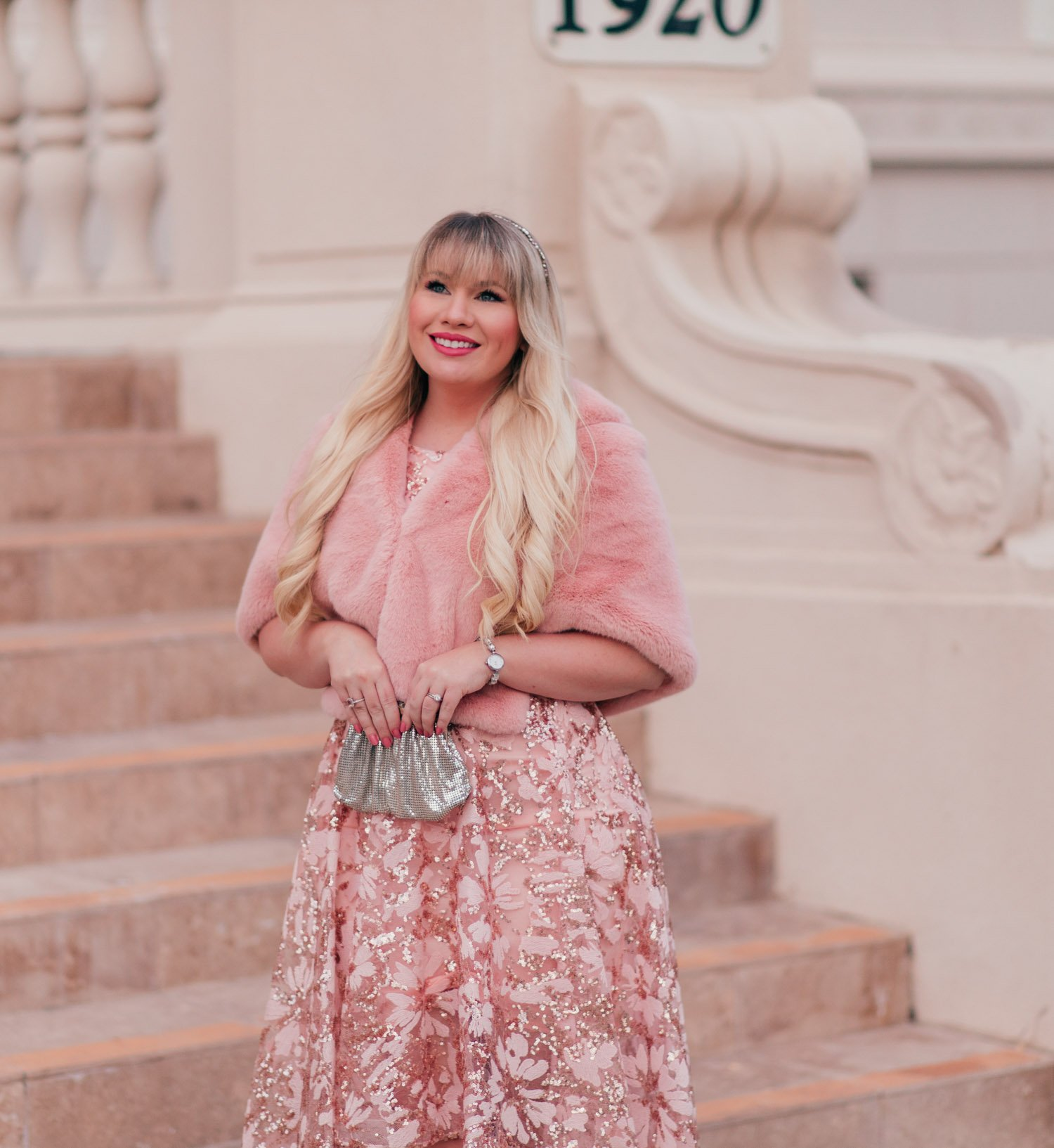 Elizabeth Hugen of Lizzie in Lace wears a pink sequined dress