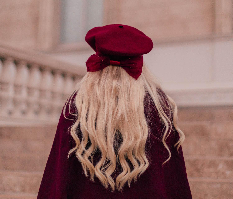 Elizabeth Hugen of Lizzie in Lace styles a red beret