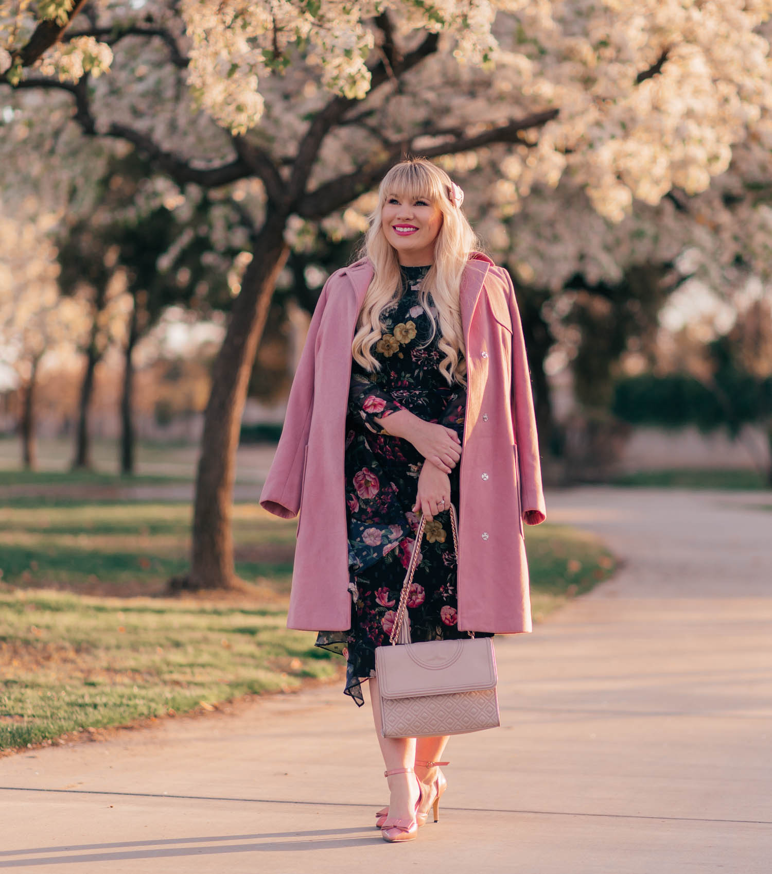 Elizabeth Hugen of Lizzie in Lace styles a black floral dress and shares fashion trends for petites