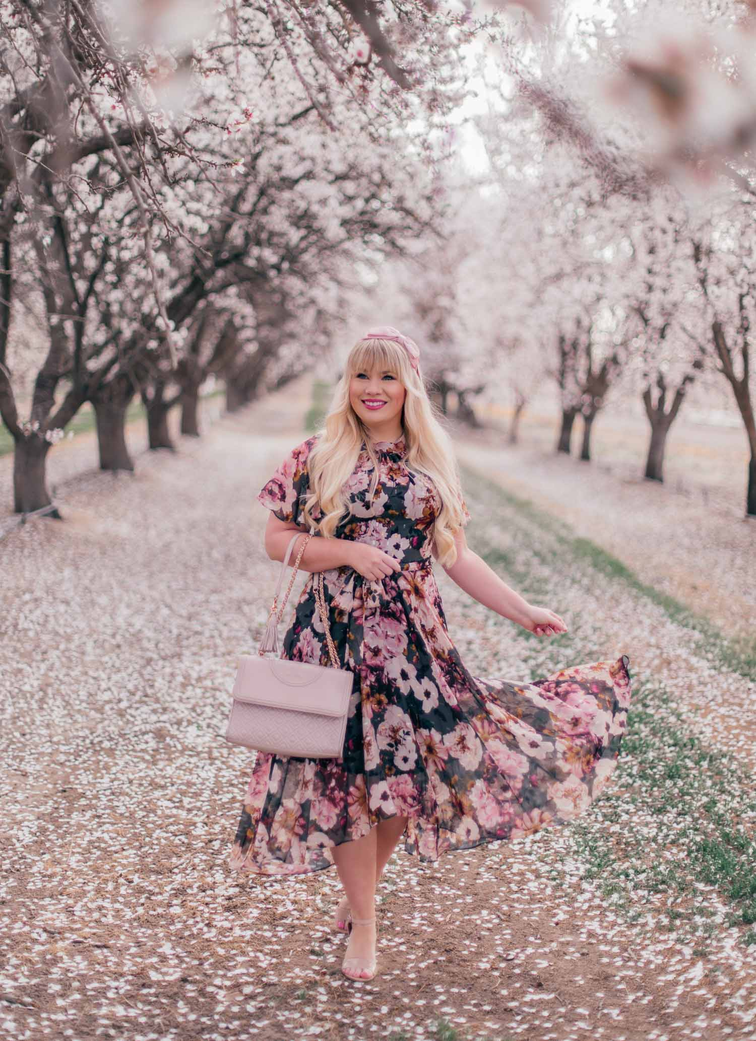Elizabeth Hugen of Lizzie in Lace wears a dark floral spring dress