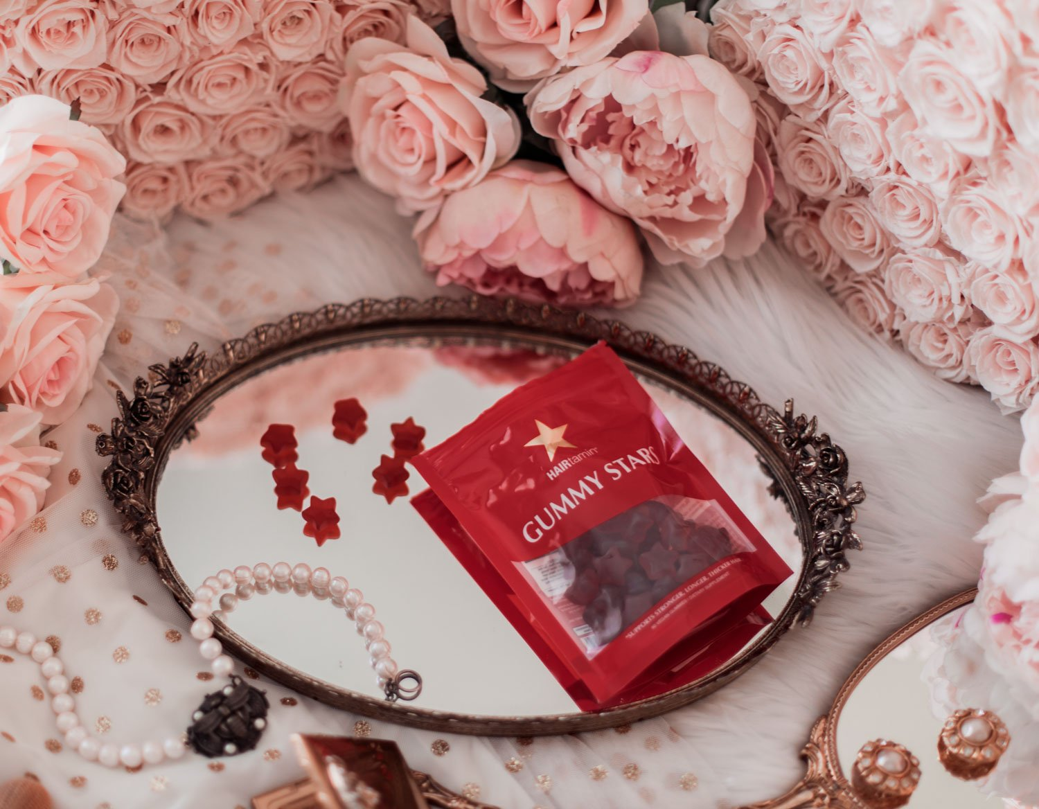 Elizabeth Hugen of Lizzie in Lace shares her Hairtamin gummy stars review