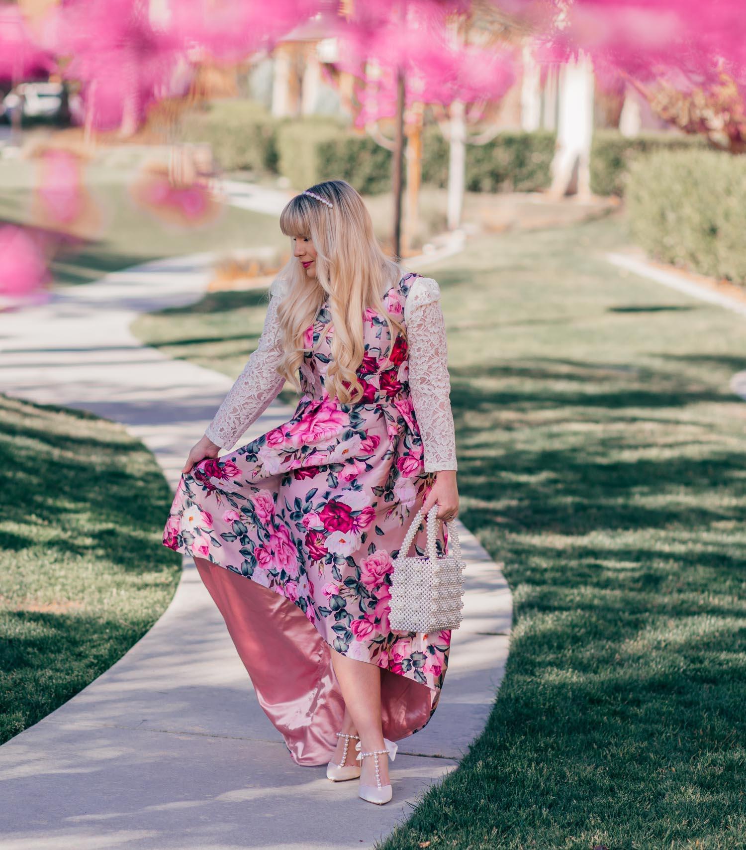 Elizabeth Hugen of Lizzie in Lace wears a pink floral dress